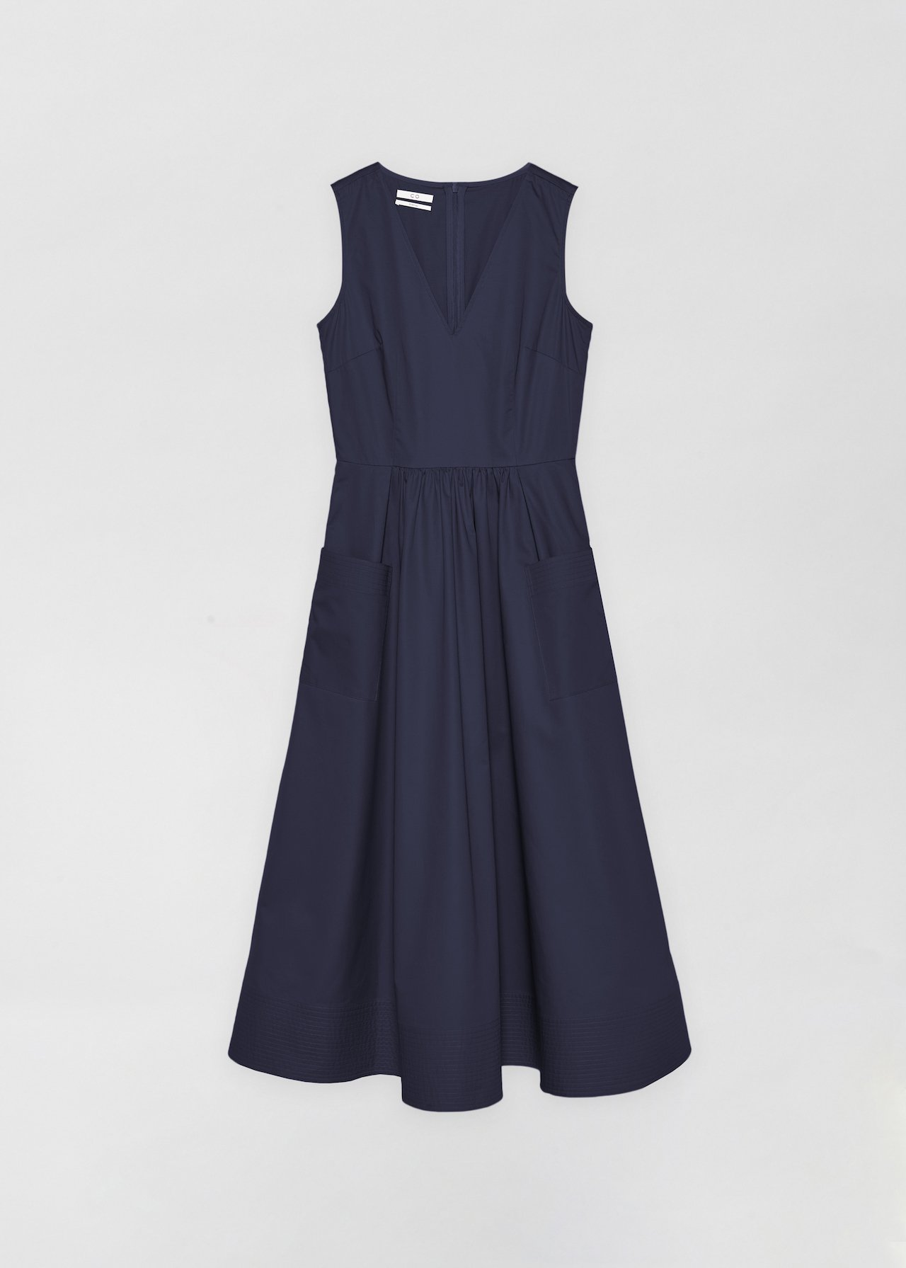 Sleeveless Trapunto Hem Dress - White in Navy by Co Collections