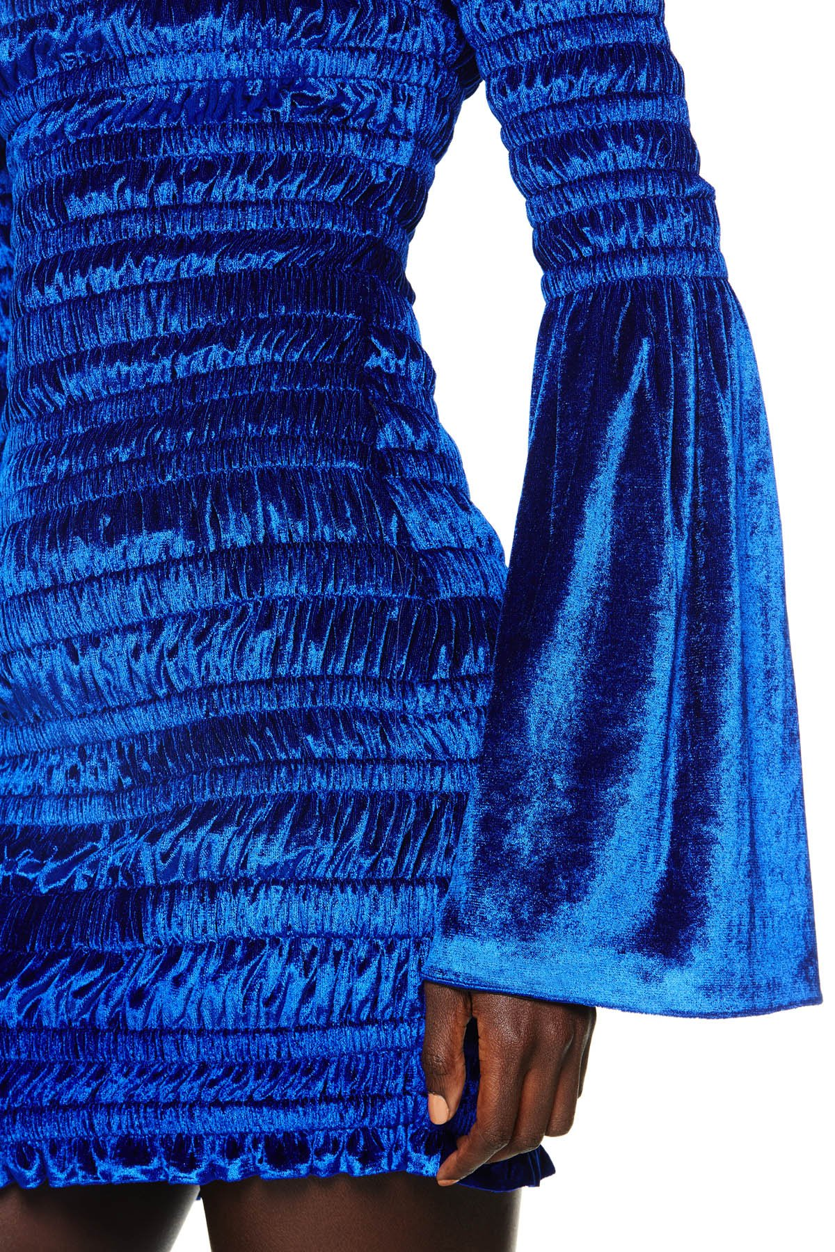 Off the shoulder long sleeve mini dress with ruched detailing. Available in Royal Blue.