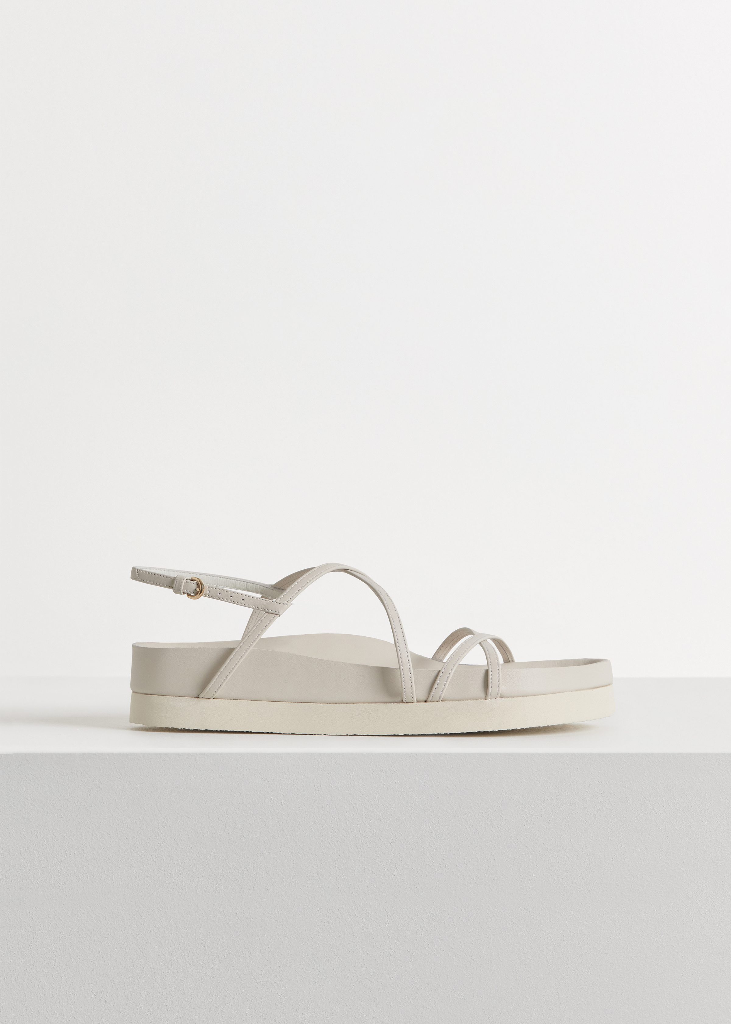 Thin Strap Sandal in Smooth Leather - Black in Ivory by Co Collections