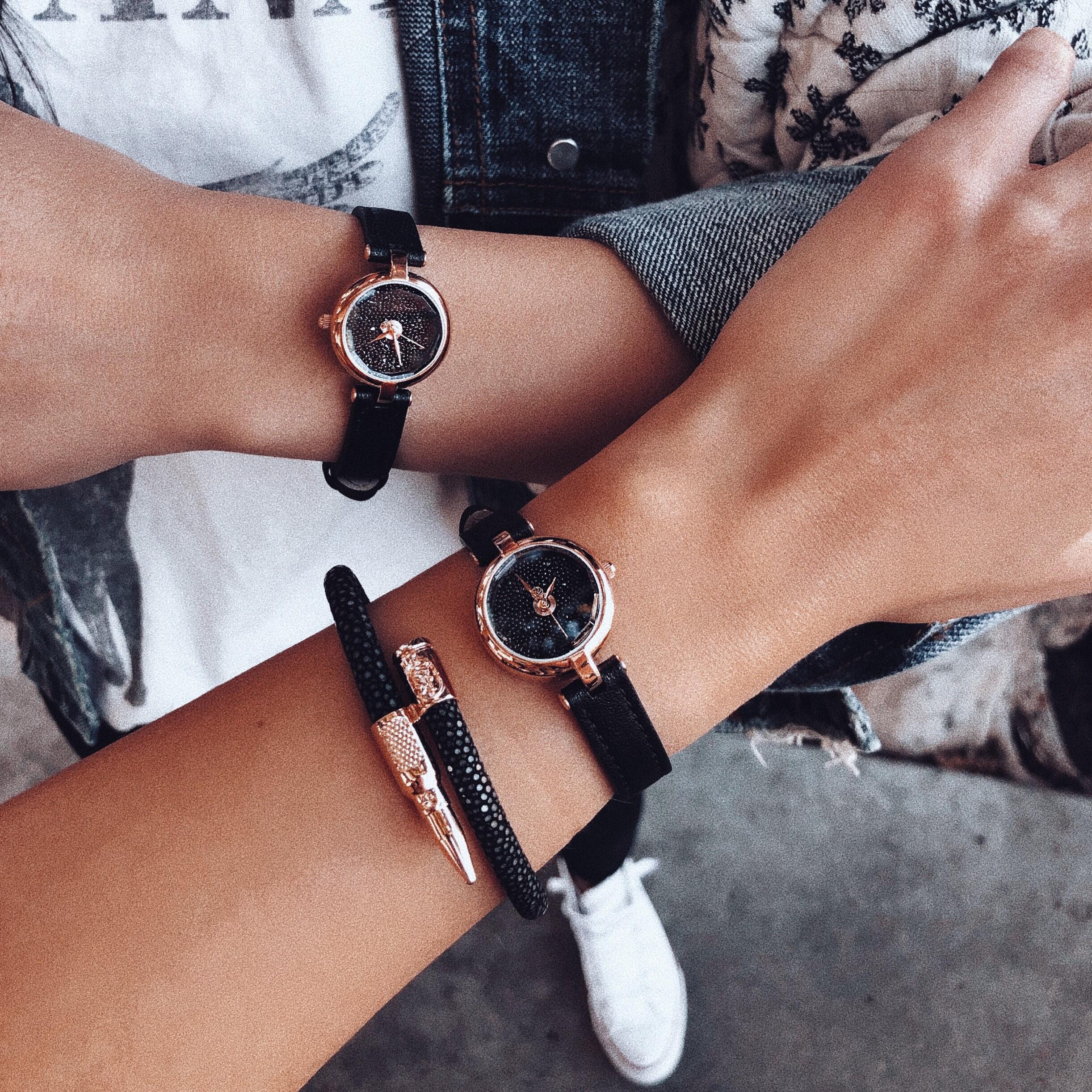 Women wearing Black Stingray Bracelet and watches