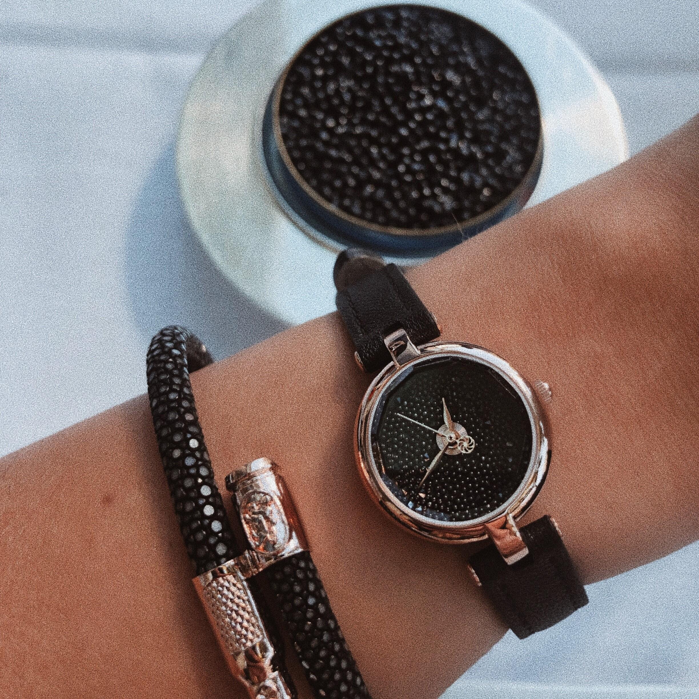 Women's Black Stingray Bracelet and watch on woman's wrist