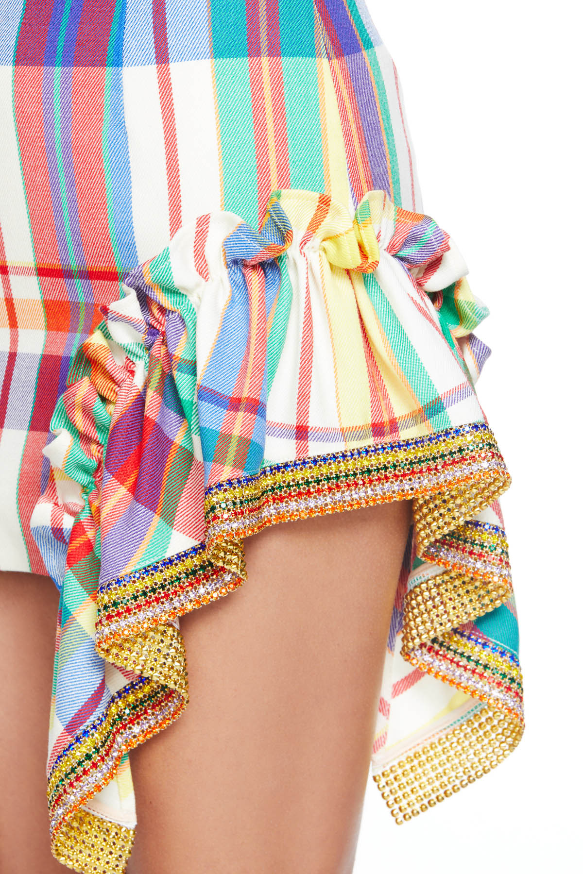 Ruffle mini skirt with crystal stripe detailing. Available in Rainbow.