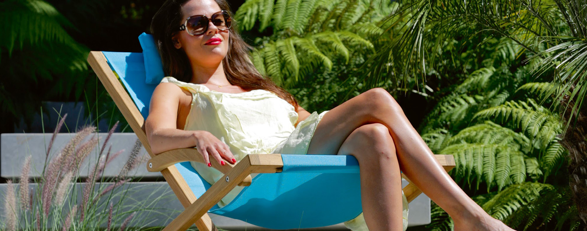Woman relaxing on Beacher deck chair