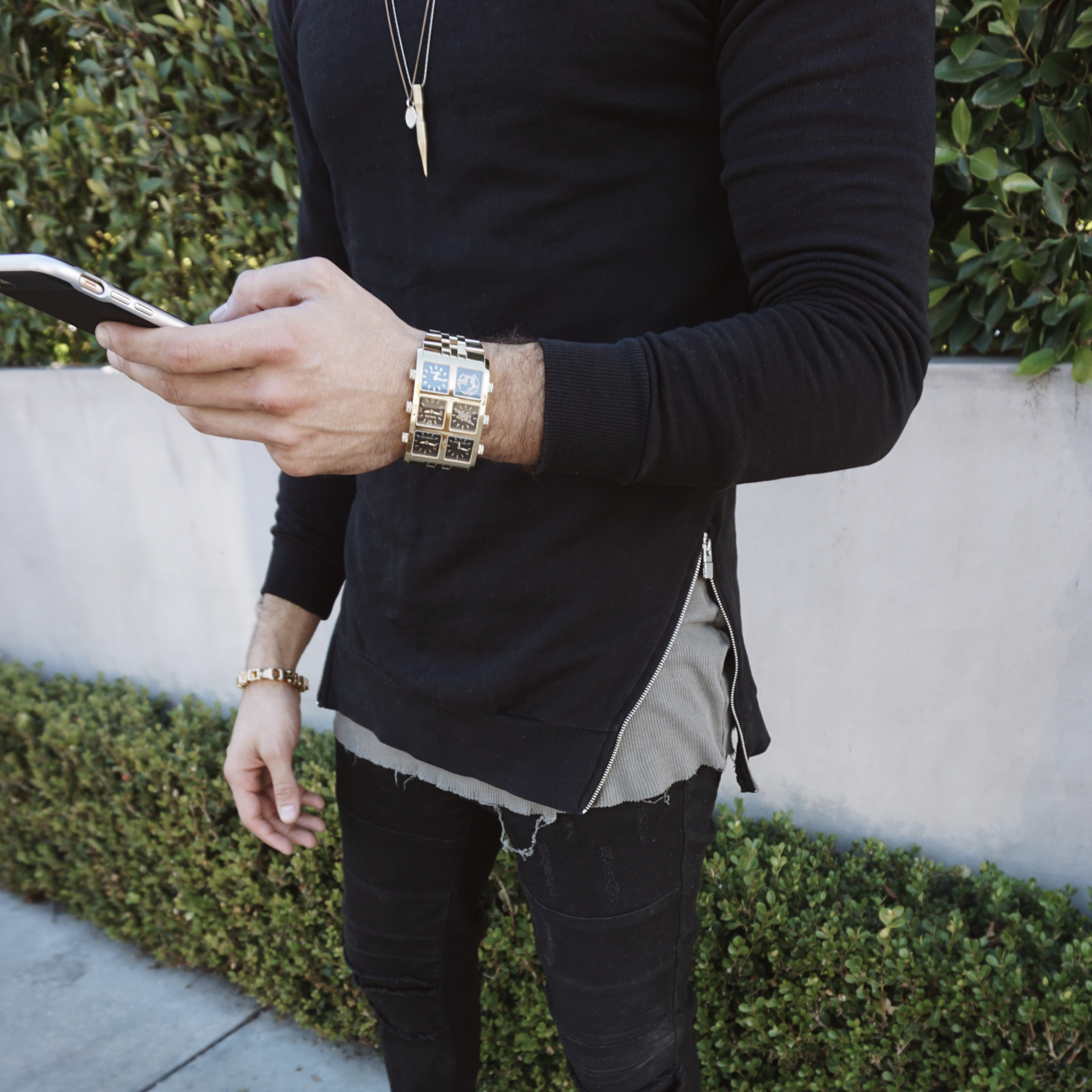 Wearing Arian 60mm Multi-Time Zone Watch holding phone