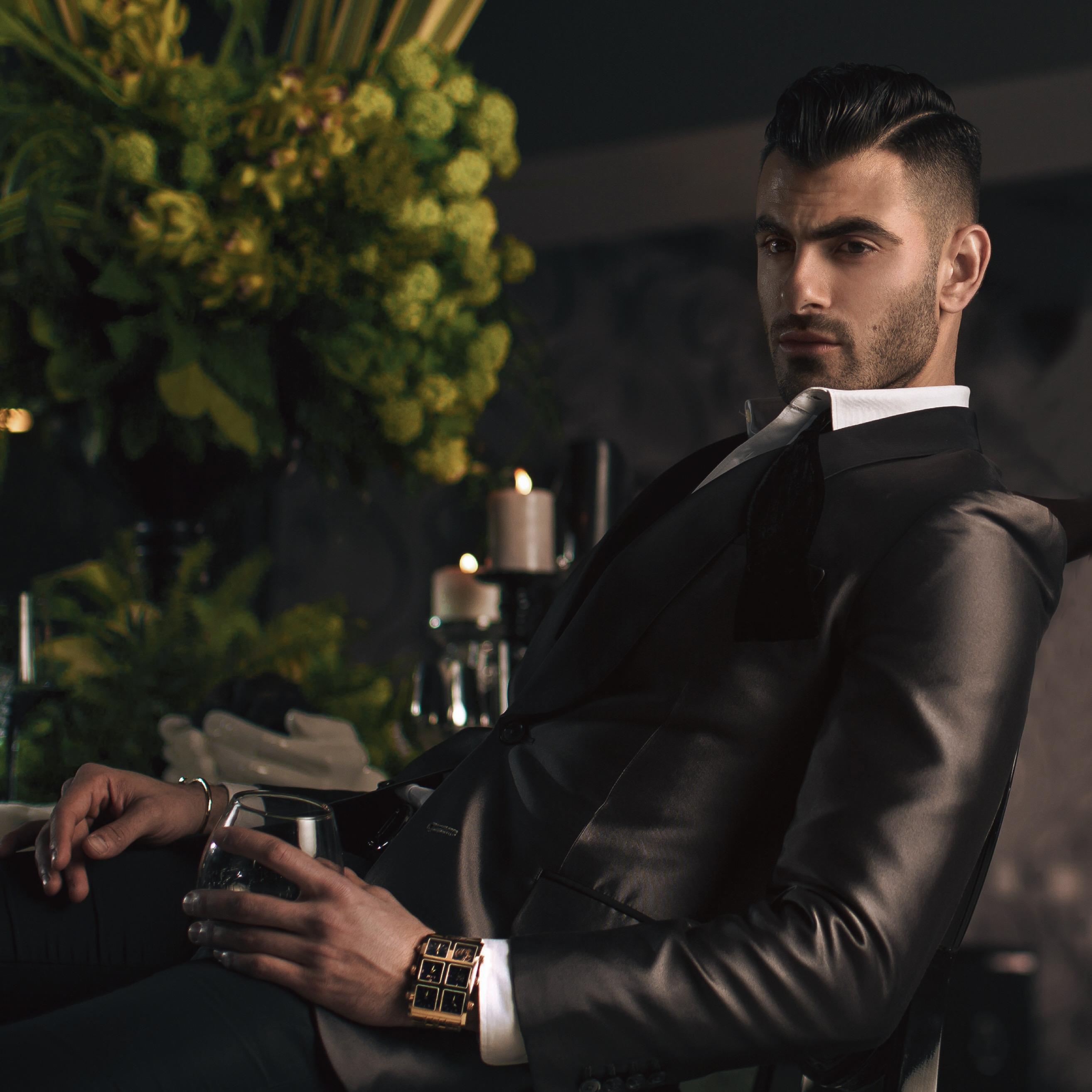 Man wearing Arian 60mm Multi-Time Zone Watch