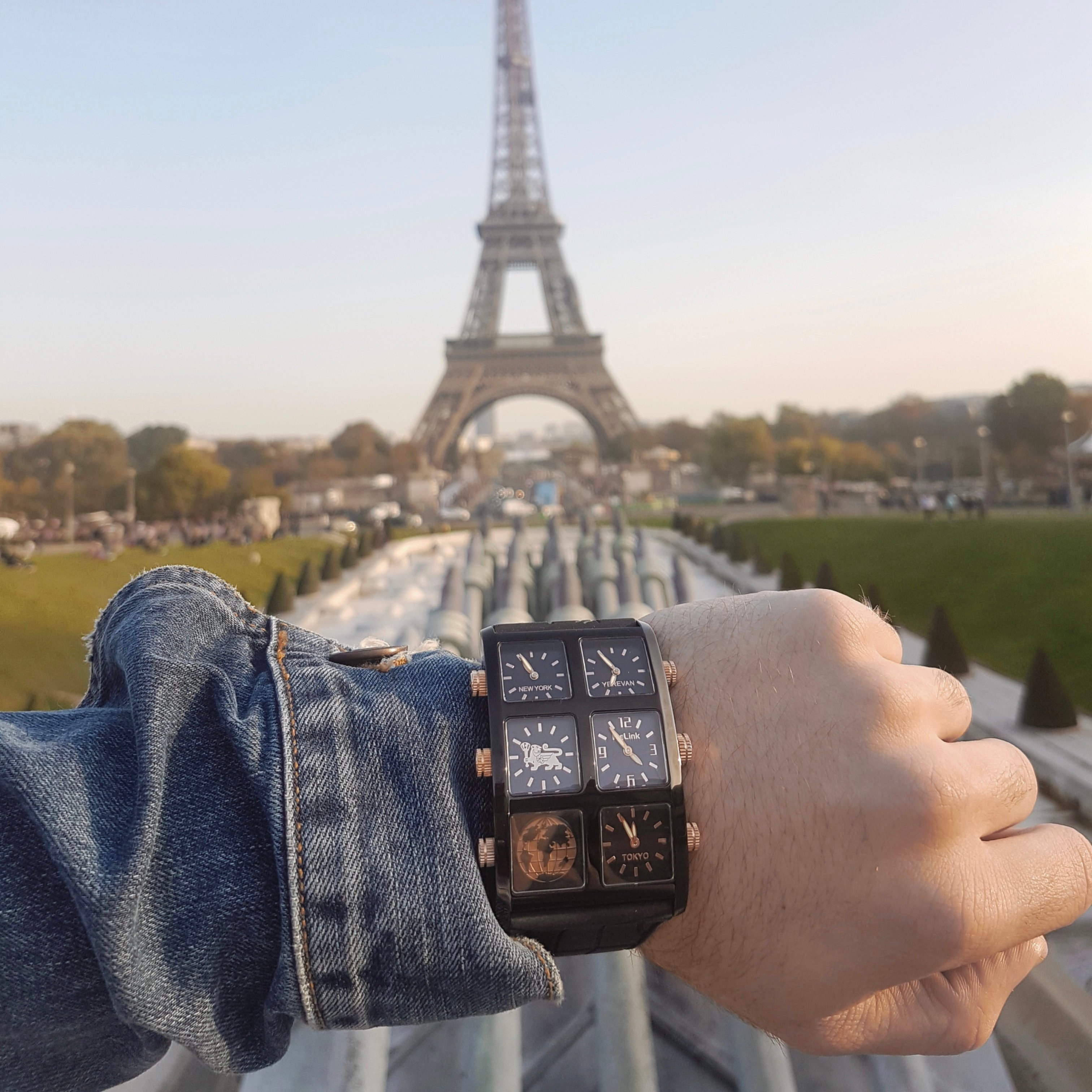 Telling time on the Jett Metal 60mm Multi-Time Zone Watch in front of the Eiffel Tower