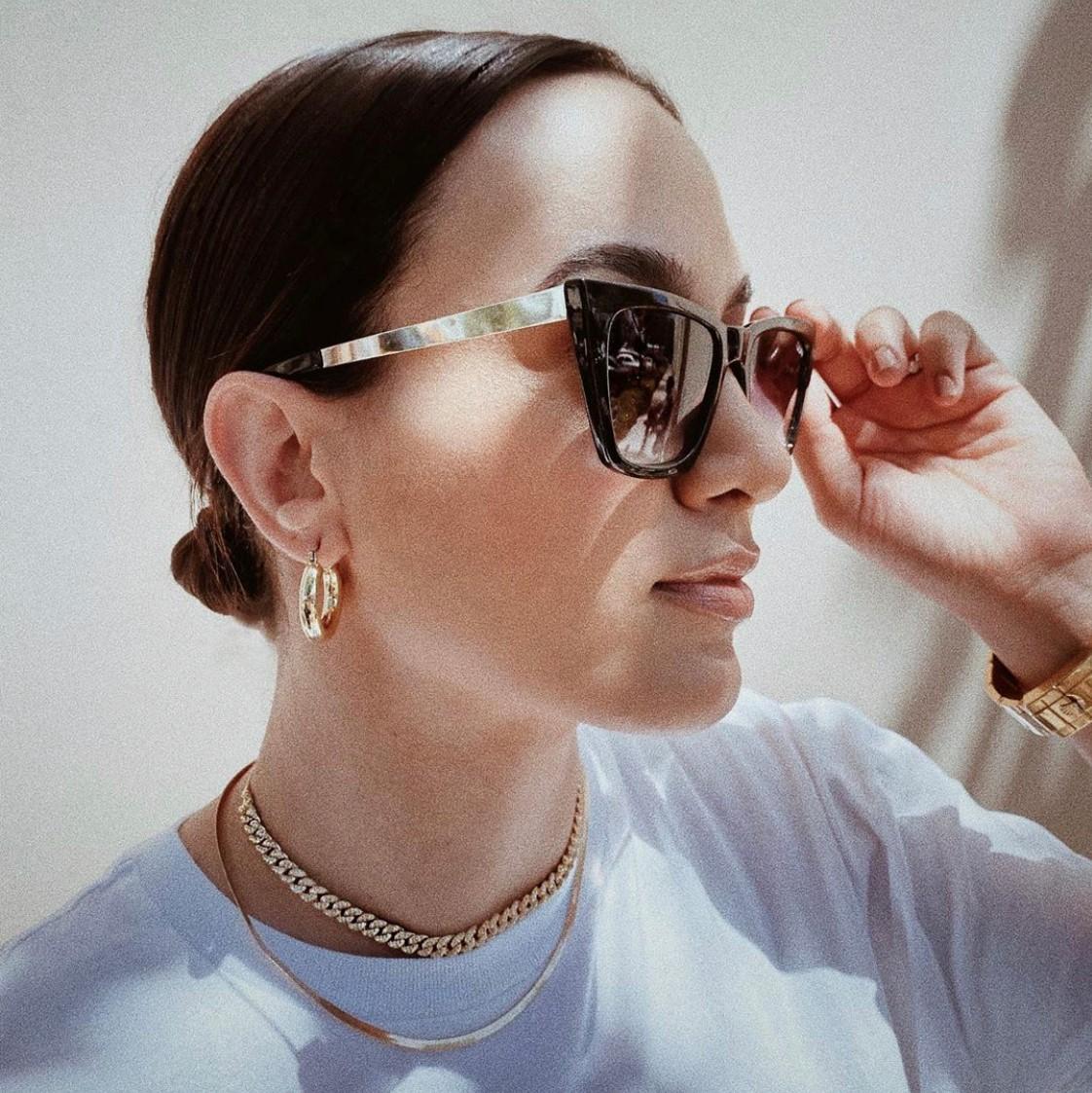 Woman with sunglasses wearing Cuban Choker