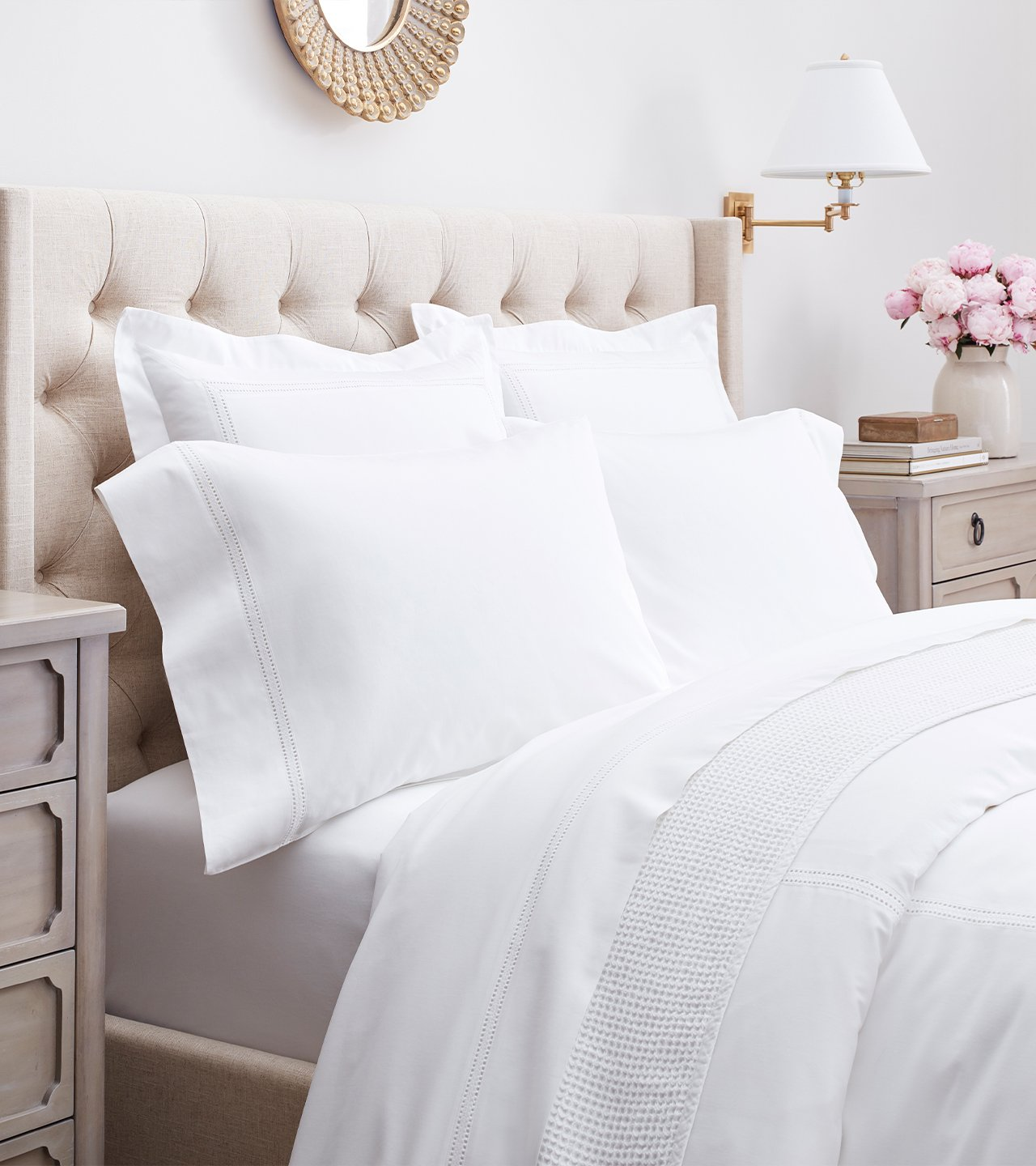 Side profile bed made with Eyelet Sheet & Duvet Set in White
