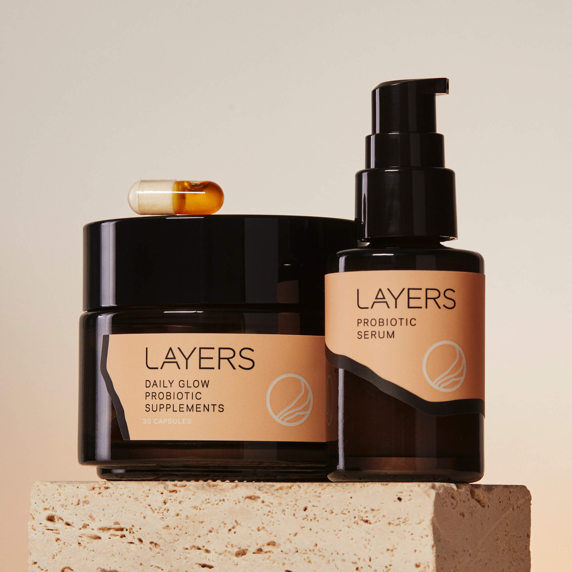 Layers Probiotic Skincare The Perfect Pair includes a 30-day jar of Daily Glow Probiotic Supplements plus a bottle of Probiotic Serum. This regimen works for dry, oily, and combination skin.