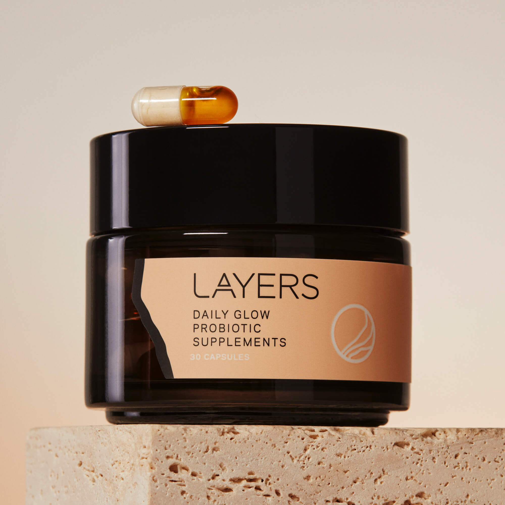 Layers Probiotic Skincare Daily Glow Probiotic Supplements. Semi-Transparent black glass jar with 30 dual-sided capsules. For dry, oily, and combination skin.