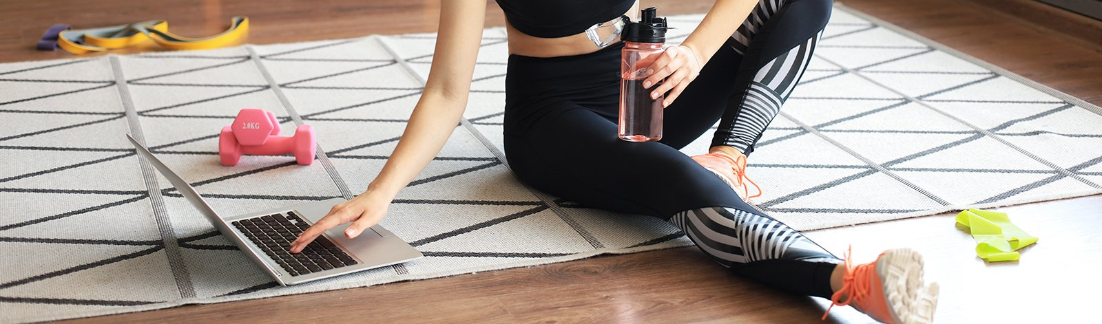 Woman sitting on the floor and working out at home