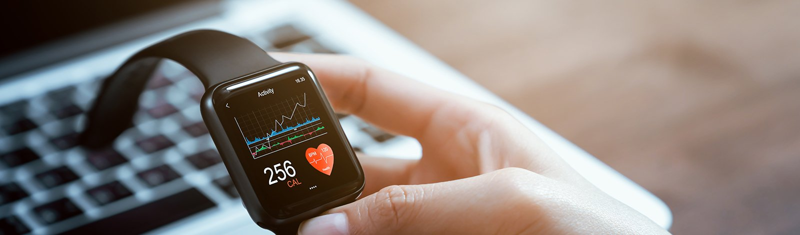 Close up of hand touching smartwatch with health app on the screen