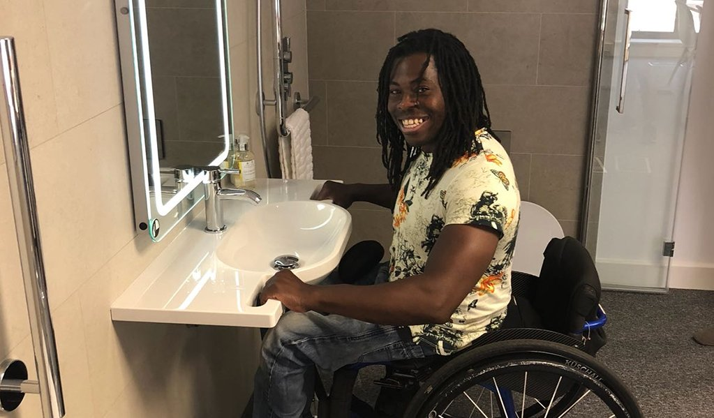One of motionspots clients, Ade smiling while testing out our hand grab basins.