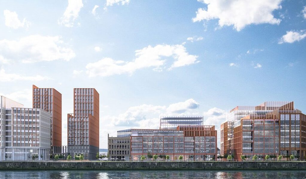 A CGI of the modern exterior view from across the water of the Barclays campus in Glasgow.
