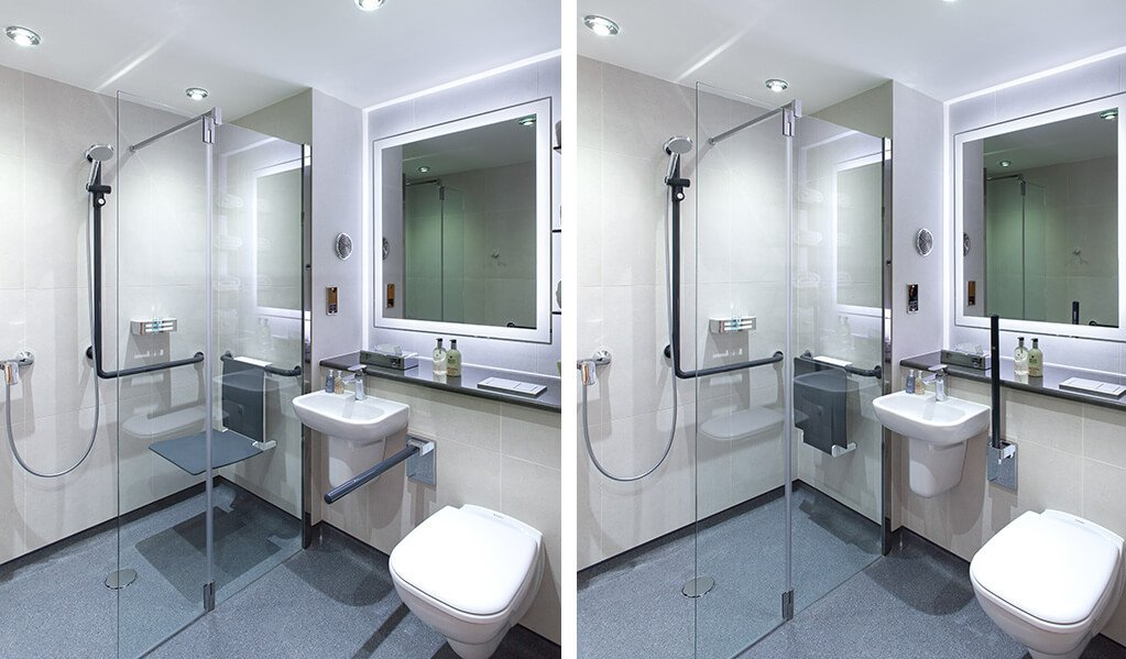 Image Split Screen Image 1 - Bathroom with wall hung white toilet, small white basin and a bifolding shower screen which homes a wall hung charcoal coloured shower seat and L shaped shower rail.  Image 2 - Bathroom with wall hung white toilet with handrail folded up, small white basin and a bifolding shower screen which homes a wall hung charcoal coloured shower seat folded up and L shaped shower.