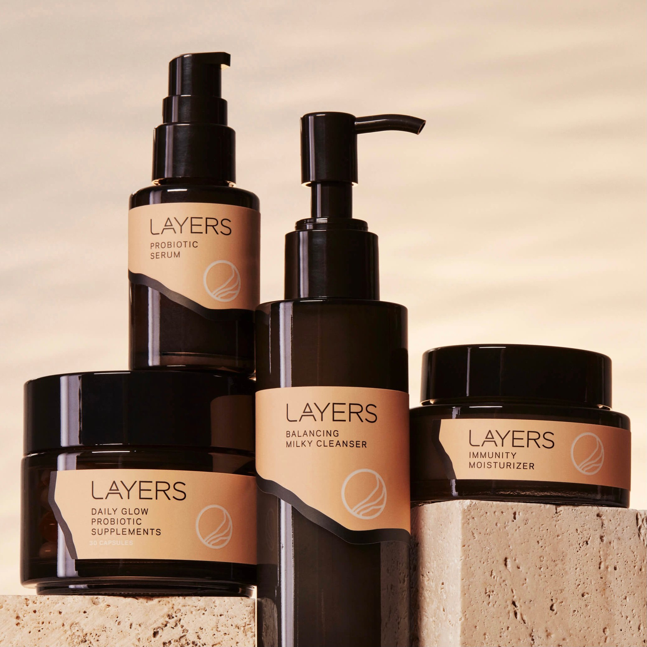 Layers Probiotic Skincare Group Product Shot with Semi-Transparent Glass Packaging and Pink Labels. For dry skin, oily skin, combination skin.