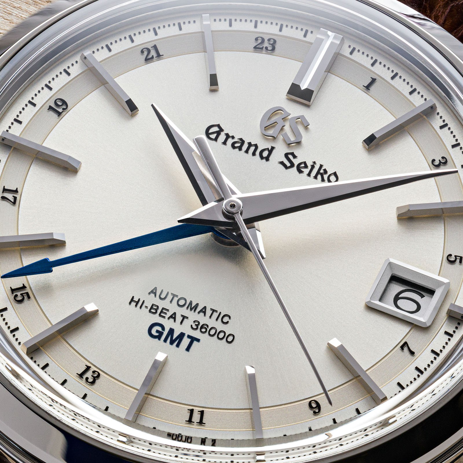 A light dial watch in a classic case with a tempered-blue GMT hand.