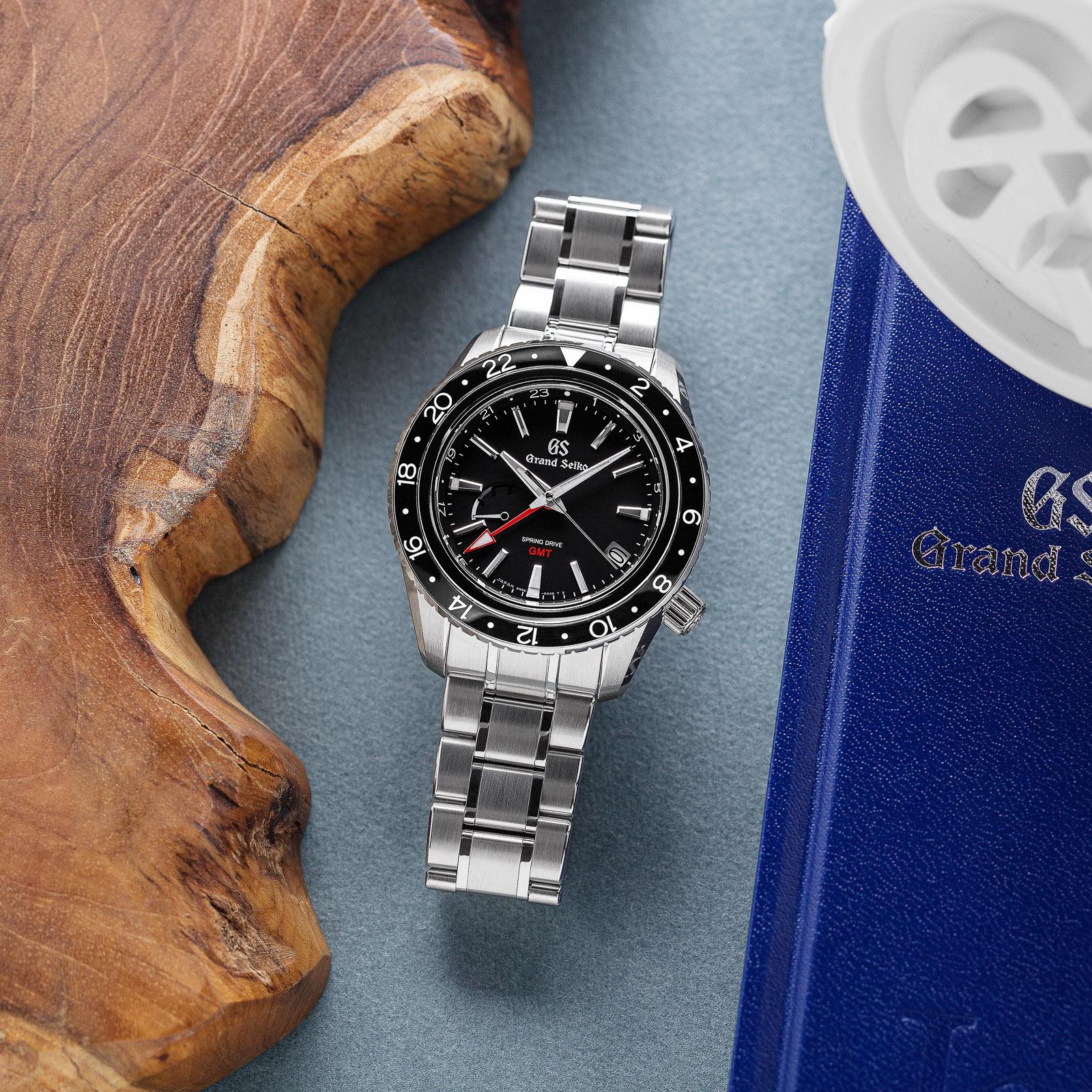 Grand Seiko SBGE201 - a black dial, black bezel stainless steel wristwatch on bracelet.