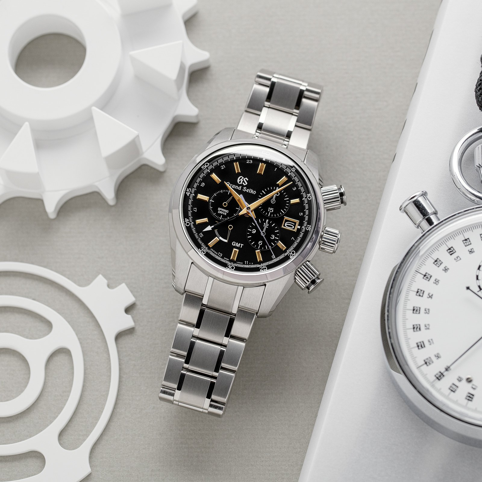 Grand Seiko SBGC205 Chronograph - black dial wristwatch with gold-tone accents.