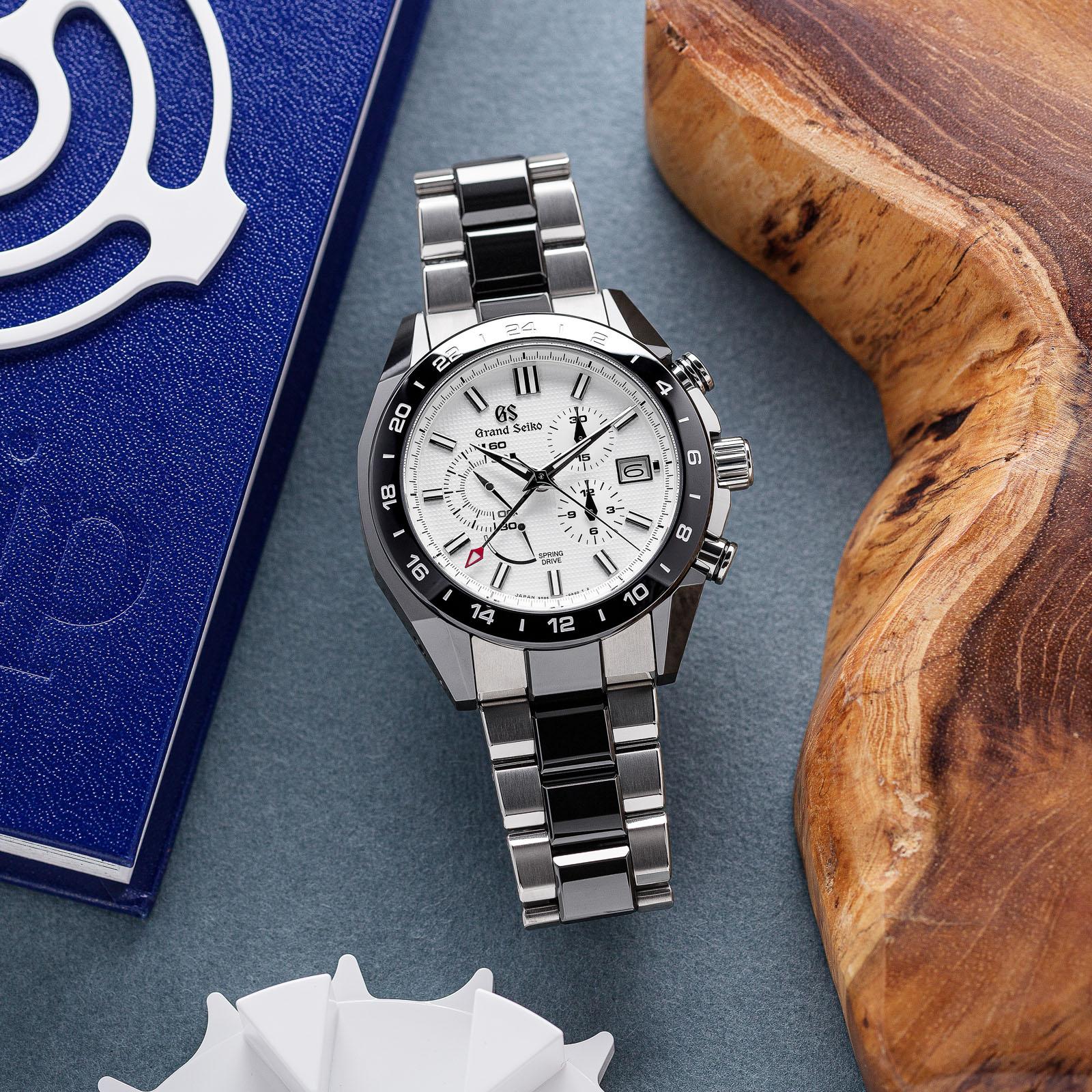Grand Seiko SBGC221 Chronograph - white dial wristwatch with a titanium and ceramic case.