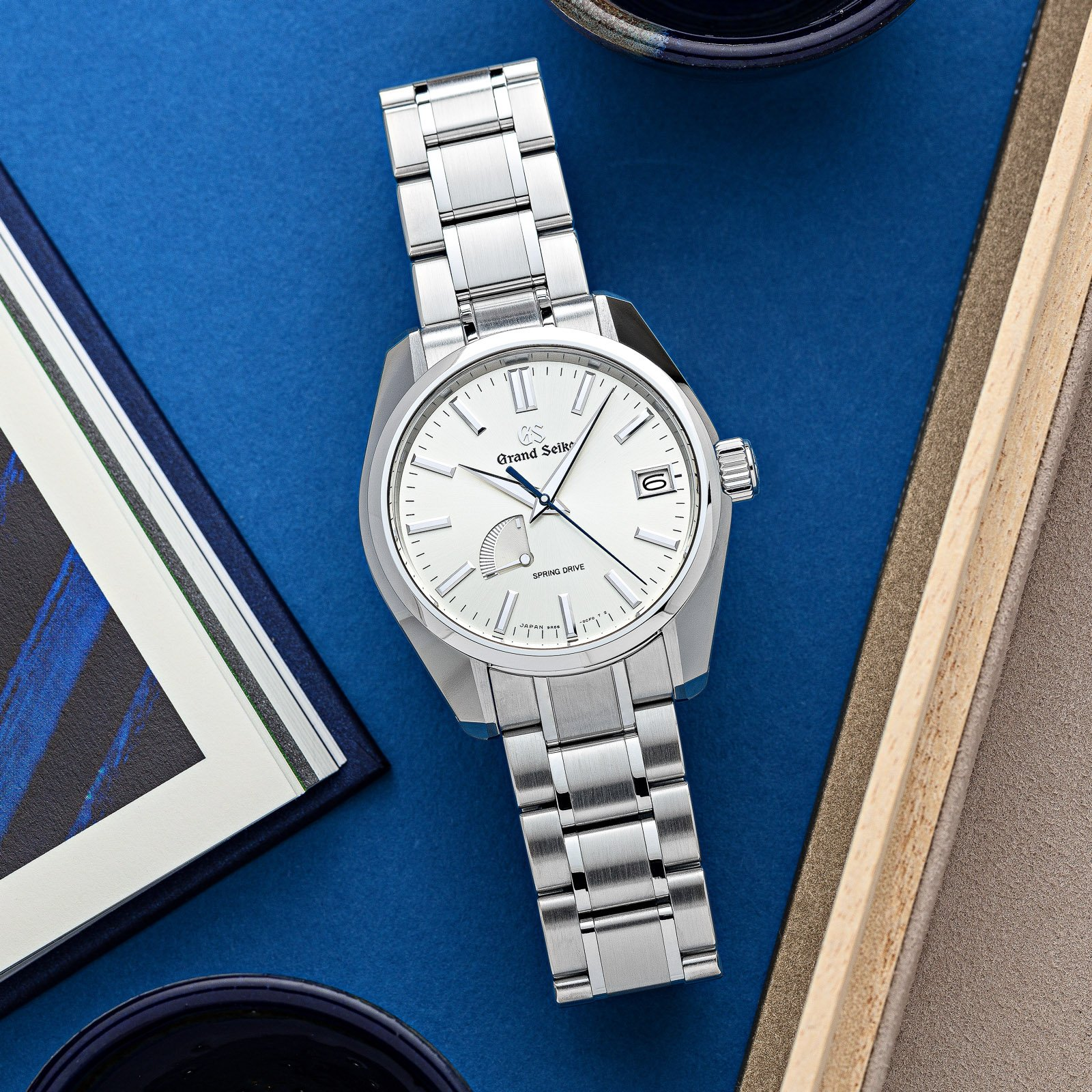 A light dial in a stainless steel case with matching bracelet.