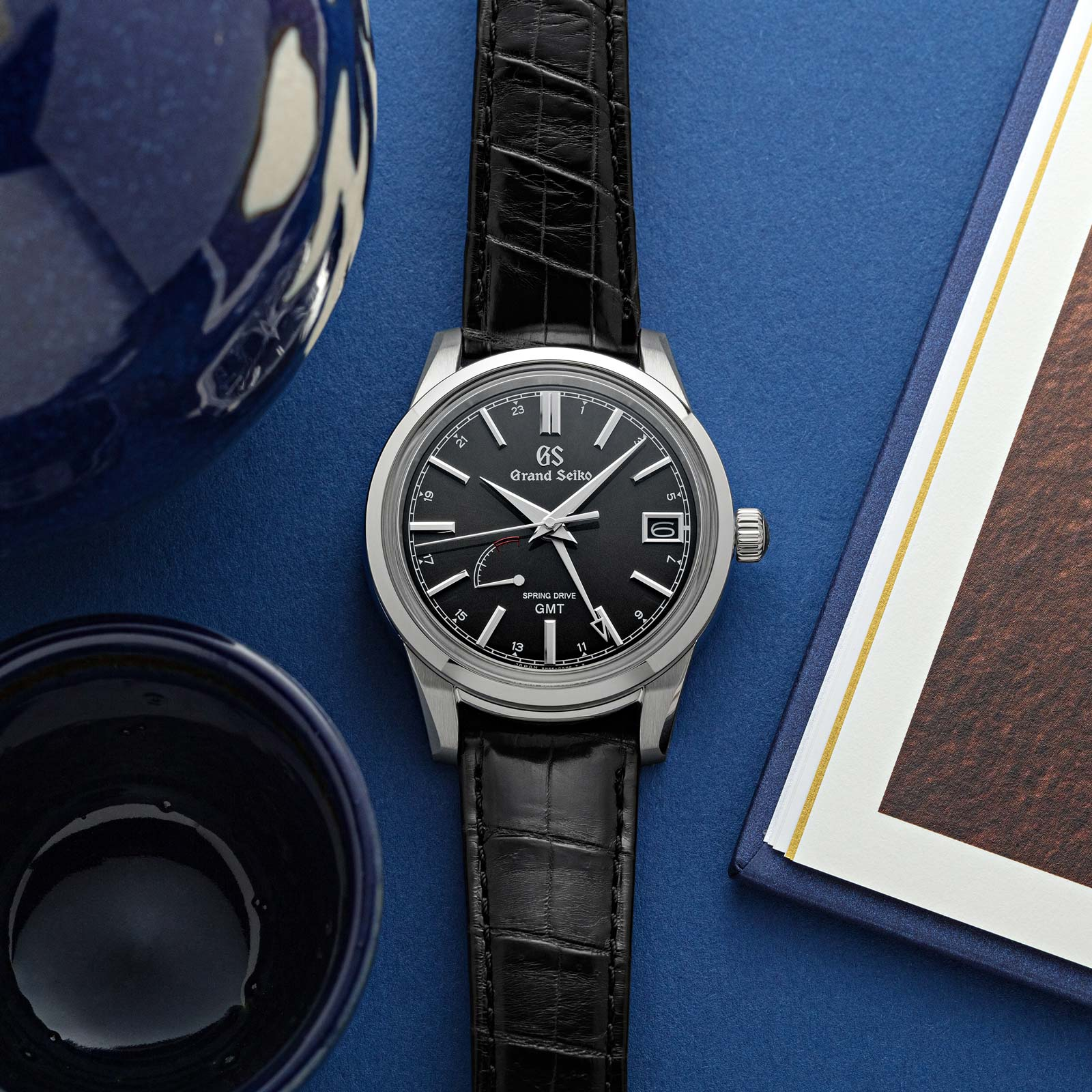 Grand Seiko SBGE227 GMT 40mm watch with a grey dial and crocodile strap.