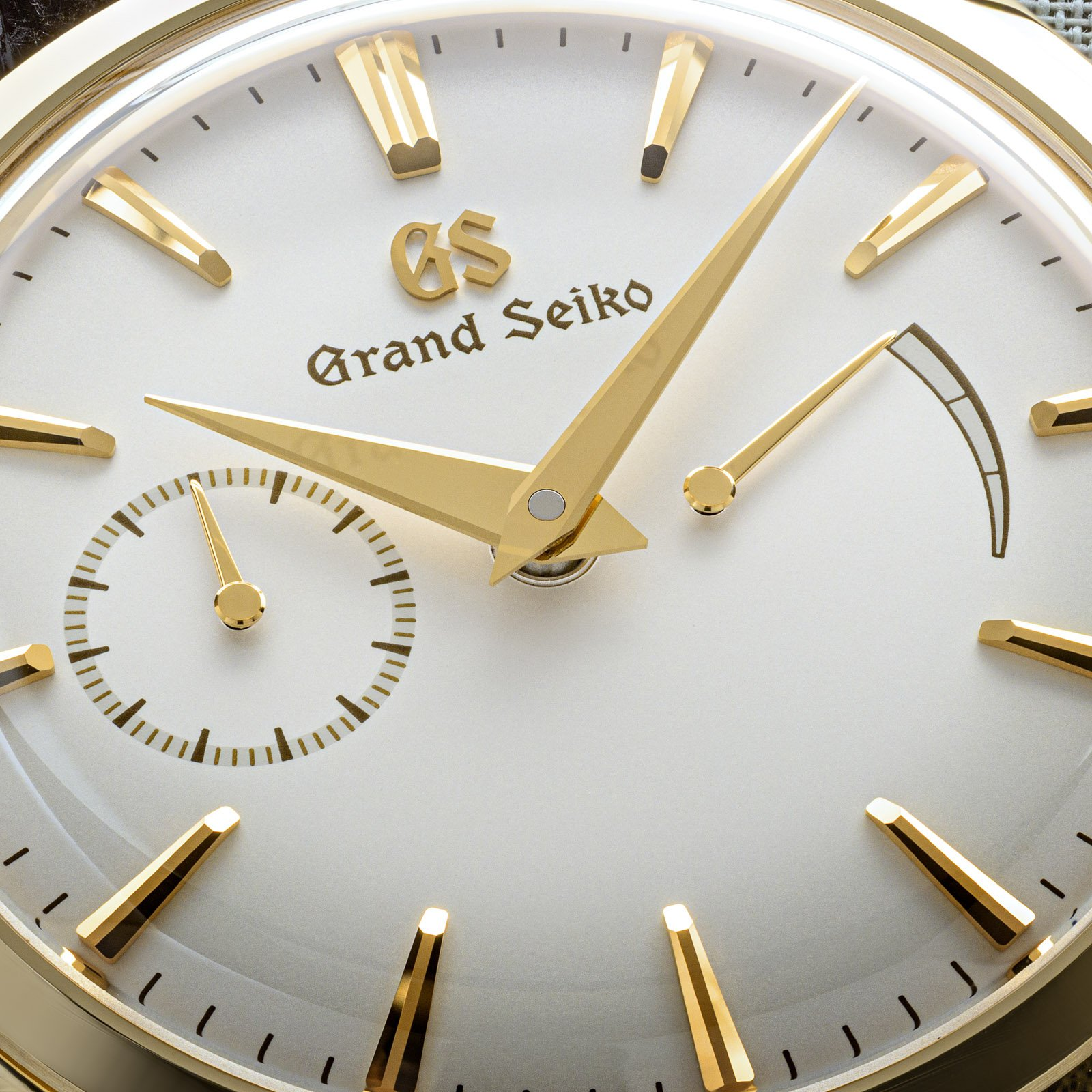 A yellow gold Grand Seiko timepiece with a light dial, and gold-tone hands and indexes.