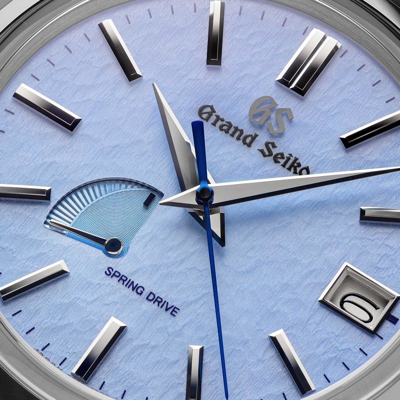 Grand Seiko SBGA407 watch with blue snowflake dial and Spring Drive 9R65 movement.