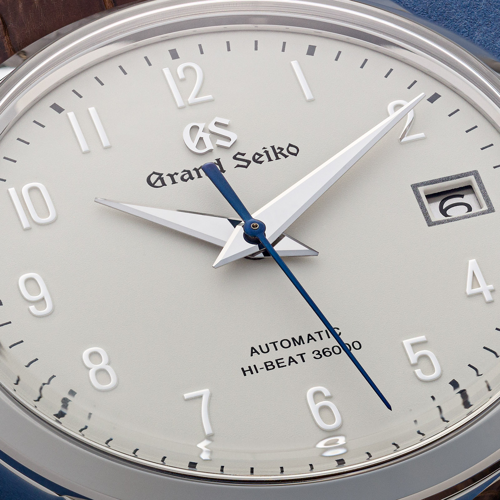 Grand Seiko stainless steel wristwatch with an ivory dial and Arabic numerals.