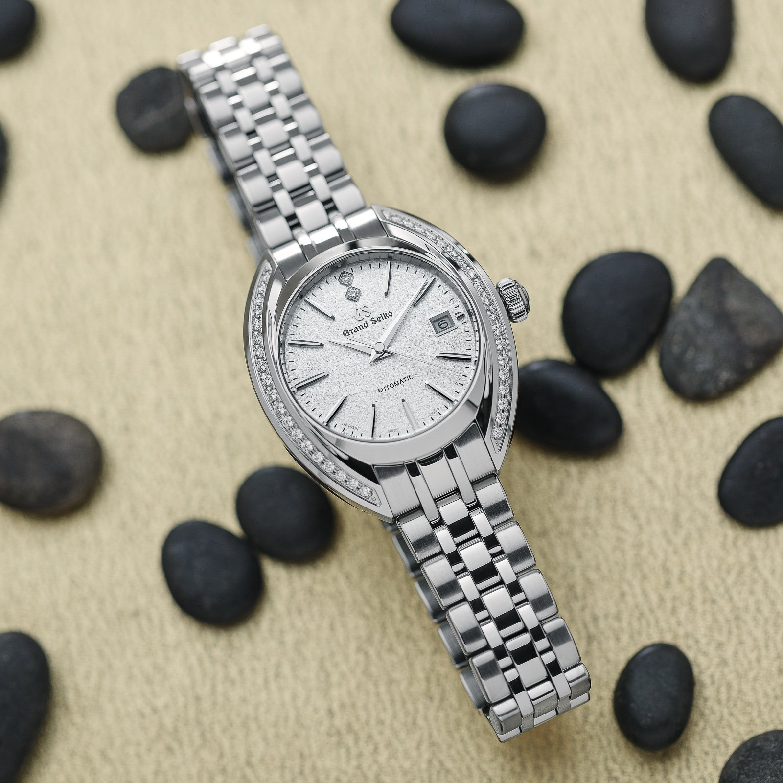 Grand Seiko wristwatch STGK011 - stainless steel case with diamonds and a white textured dial.