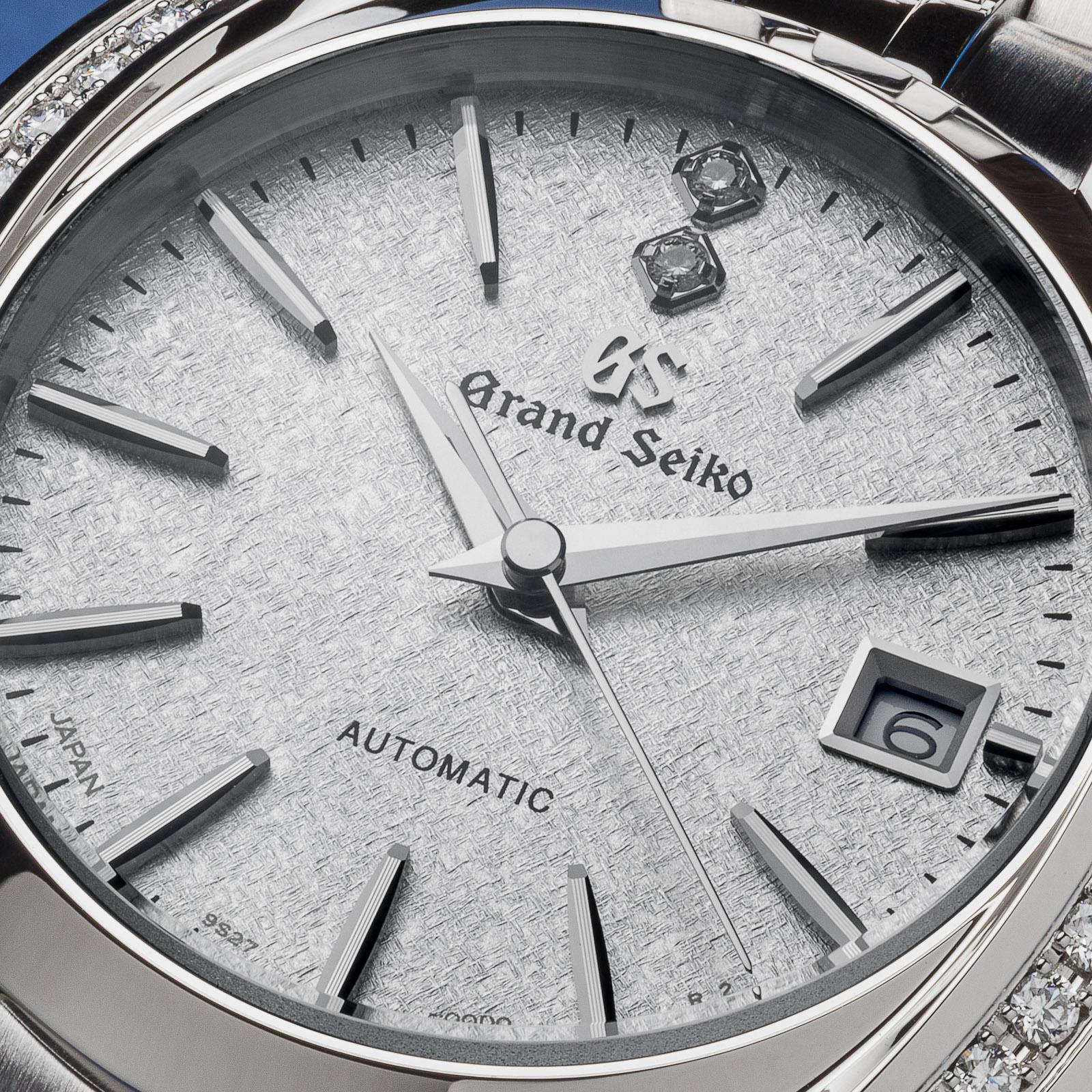 Grand Seiko wristwatch STGK011 - macro of white textured dial.