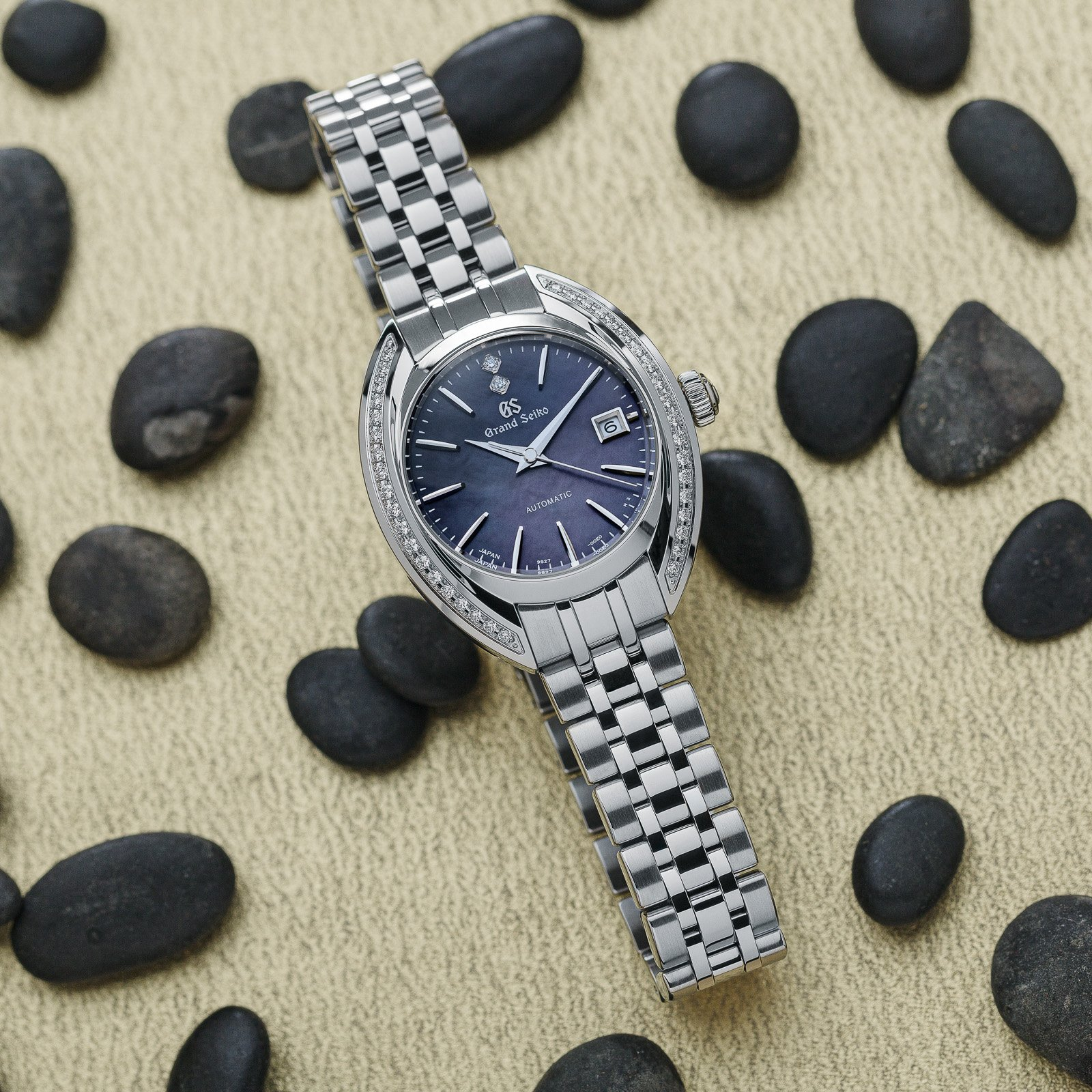 Grand Seiko wristwatch STGK013 - stainless steel case with diamonds and a dark textured dial.