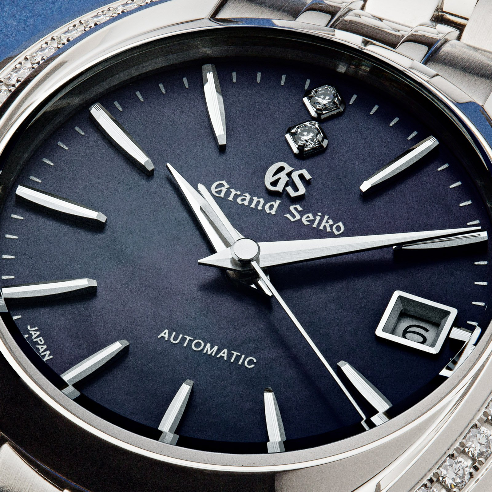 Grand Seiko wristwatch STGK013 - macro of the dark textured dial.