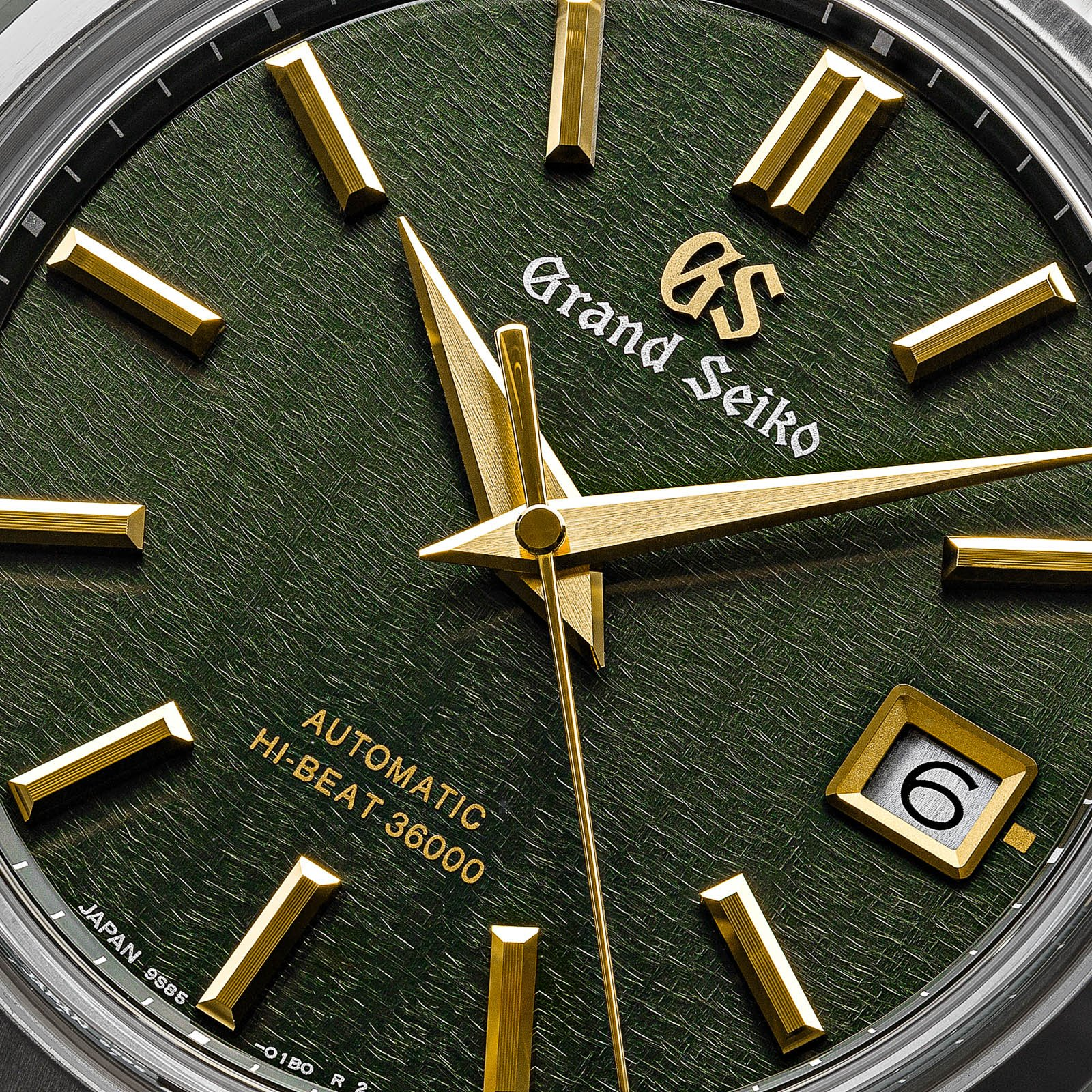 Green dial with gold-tone indexes and hands.
