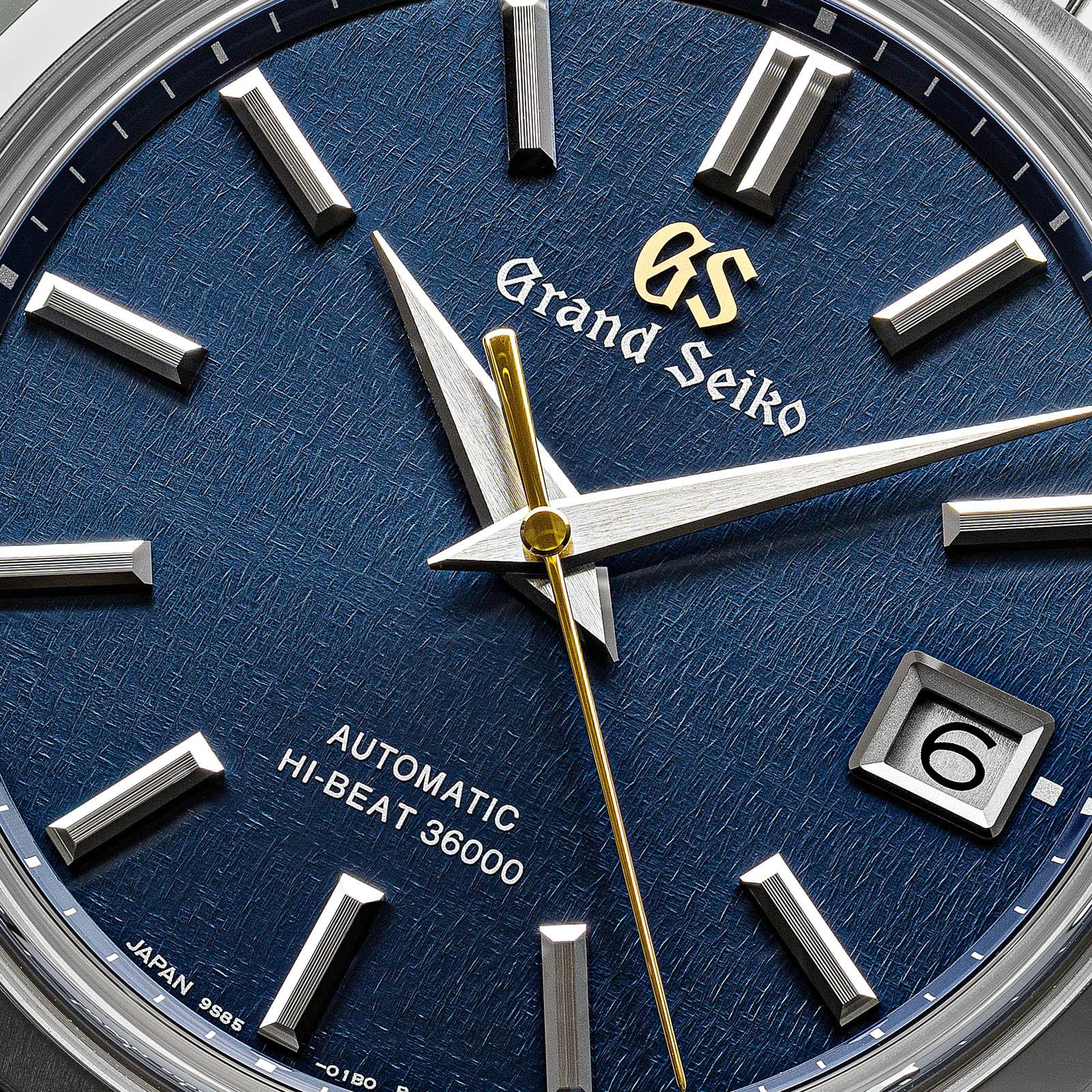 Closeup of a blue textured watch dial.