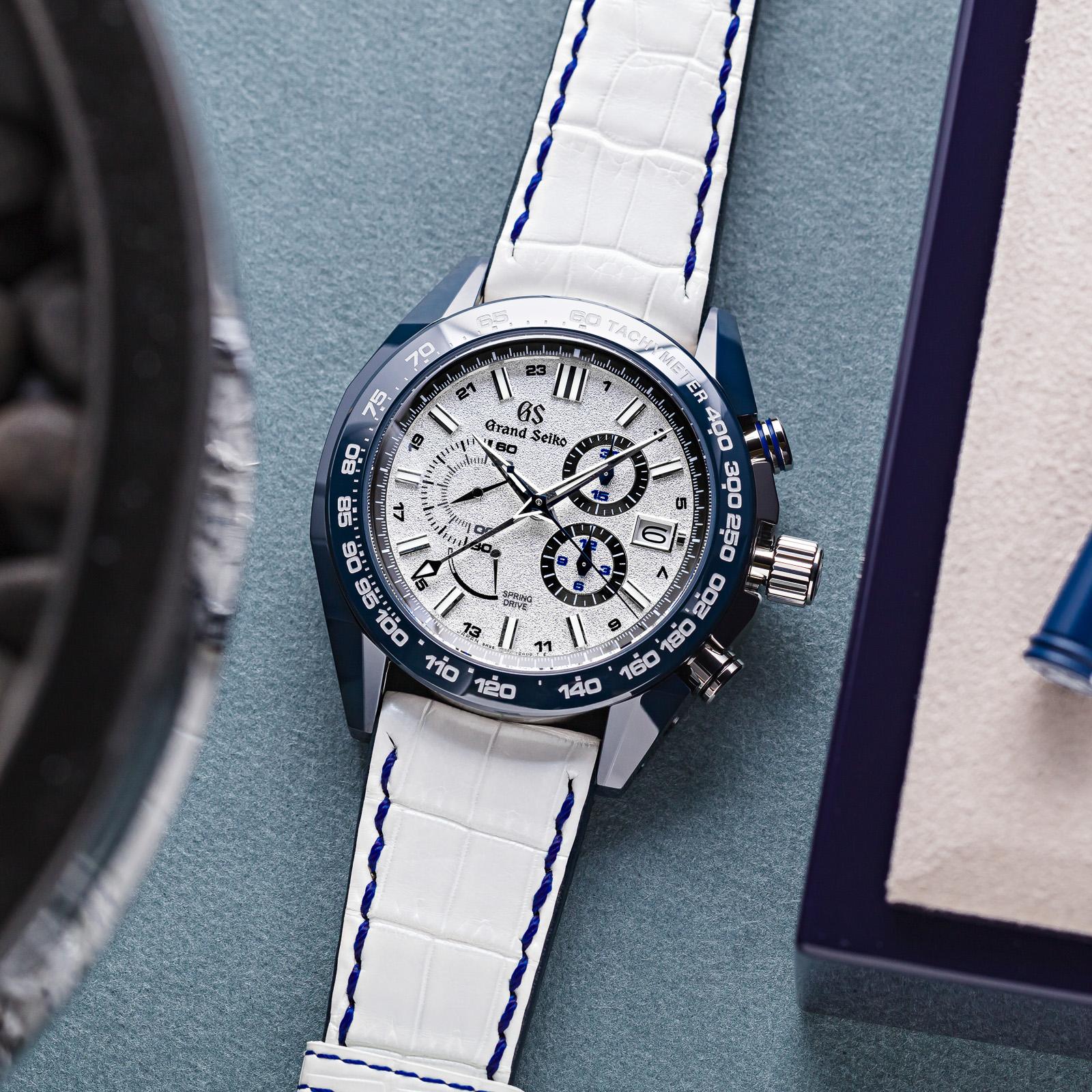 Grand Seiko Chronograph SBGC229 - a white dial wristwatch with a hybrid blue ceramic and titanium case.