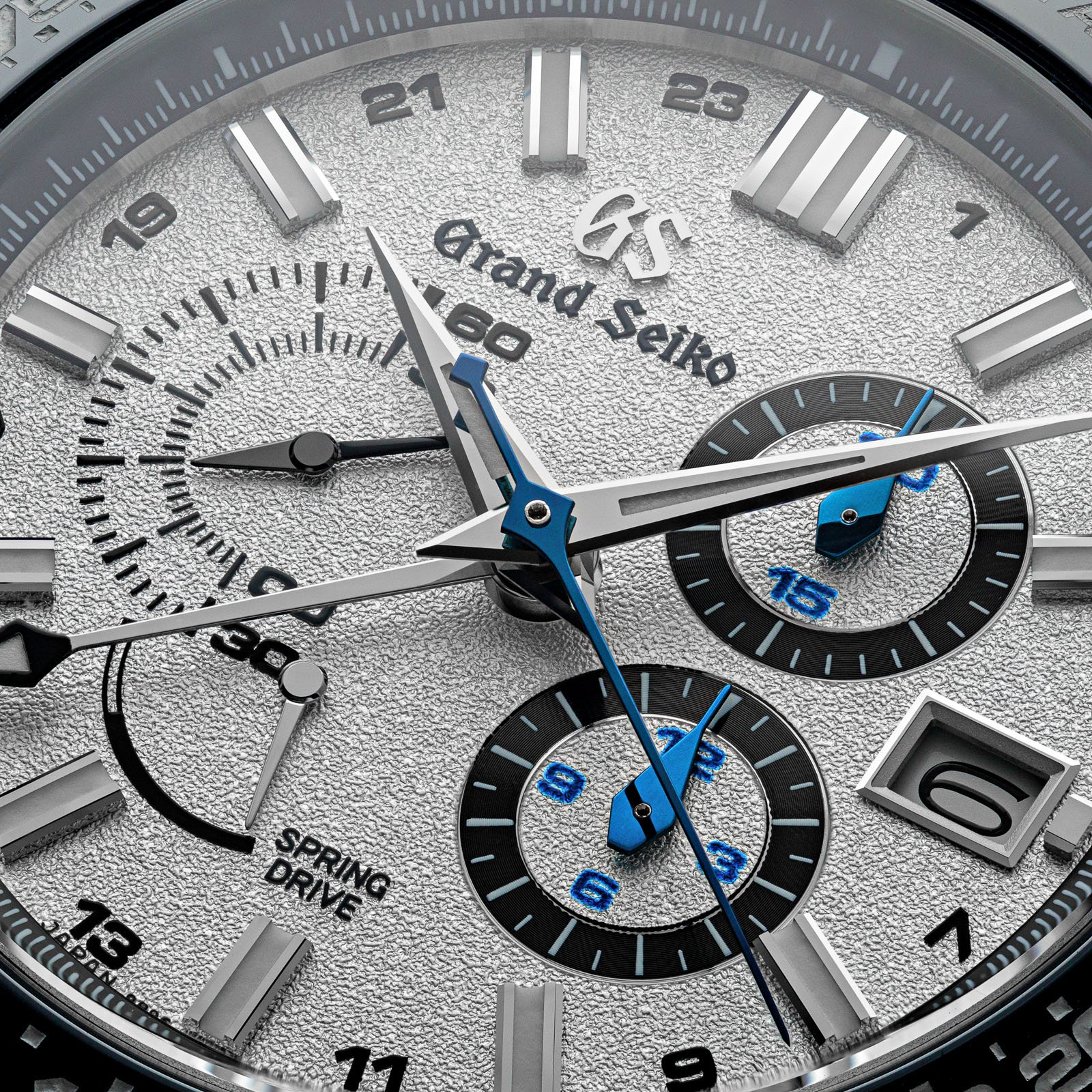 Grand Seiko Chronograph SBGC229 - macro of white dial wristwatch with blue accents.