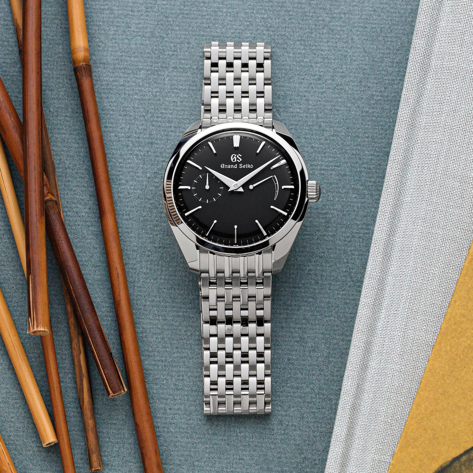 Grand Seiko SBGK009 grey dial stainless steel case and bracelet men's dress watch.