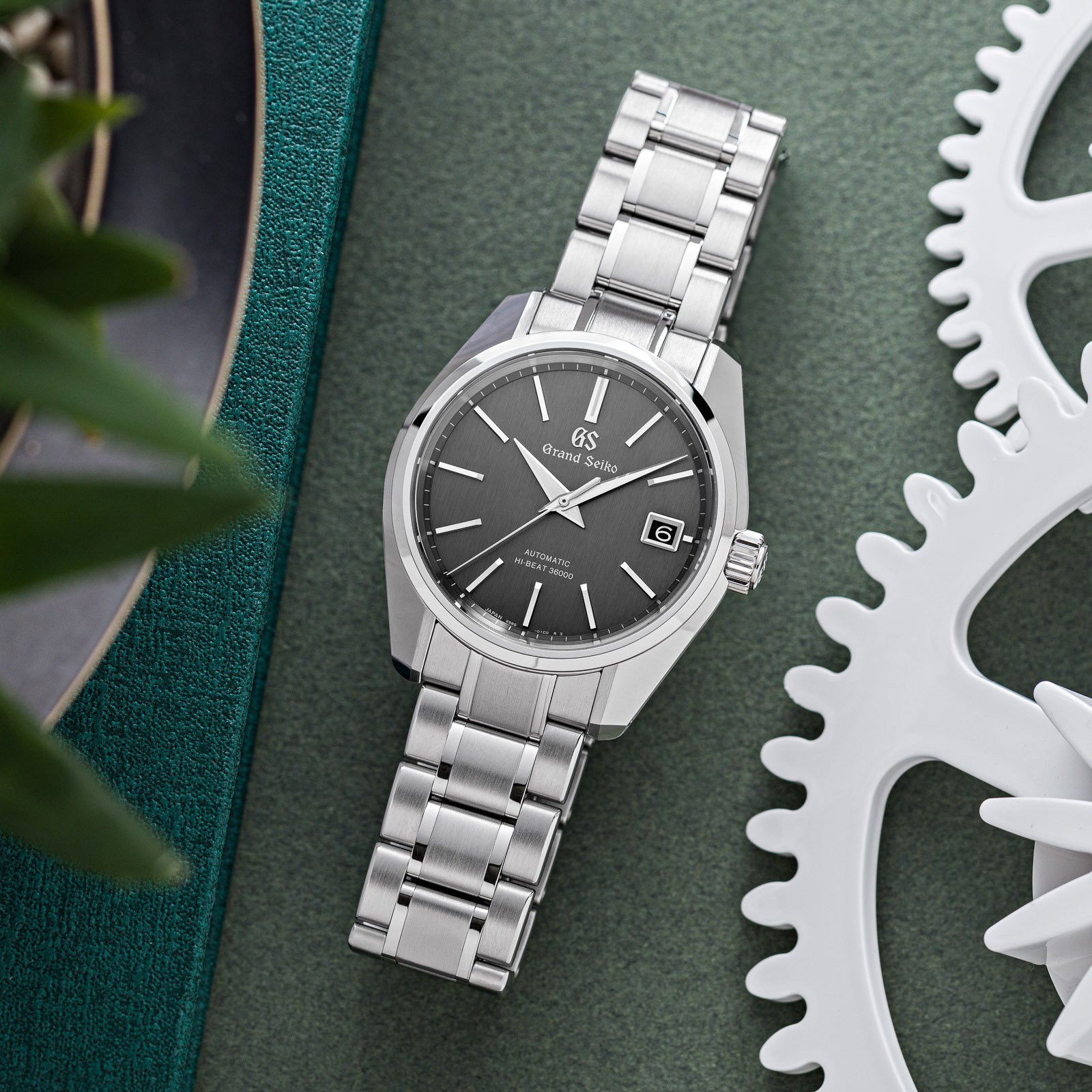 Dark gray dial wristwatch with a stainless steel case.