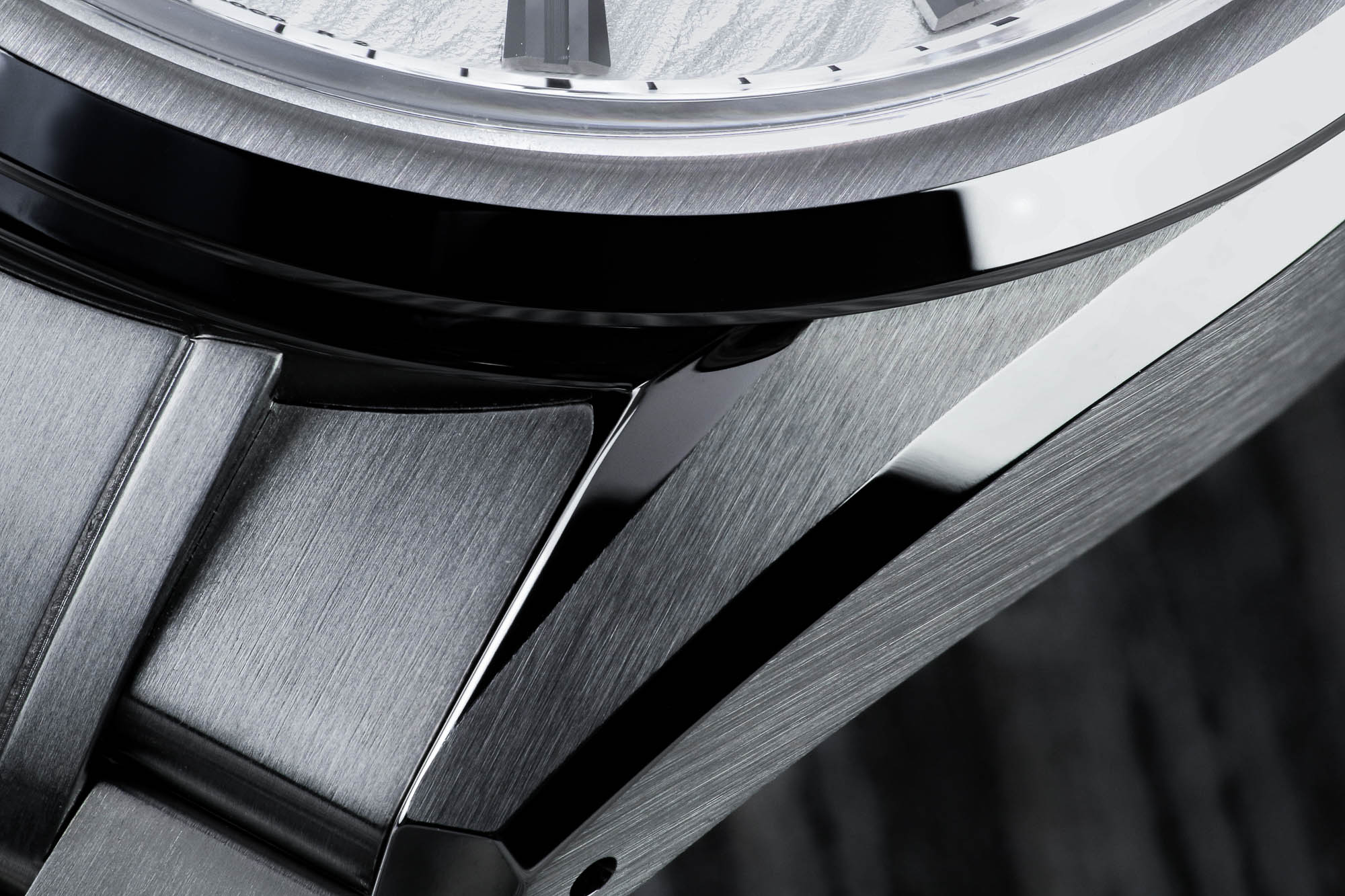 A macro detail of the stainless steel case of Grand Seiko SLGH005.
