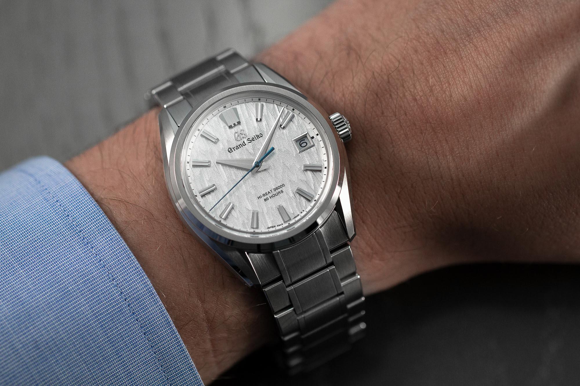 Grand Seiko SLGH005 stainless steel wristwatch worn on the wrist.