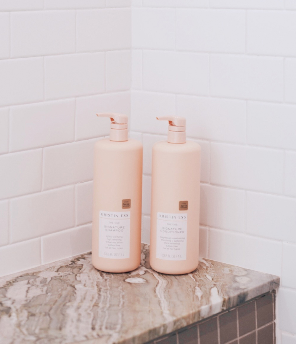 Kristin Ess Hair The One Signature Shampoo and Conditioner One Liter Bottles in Shower