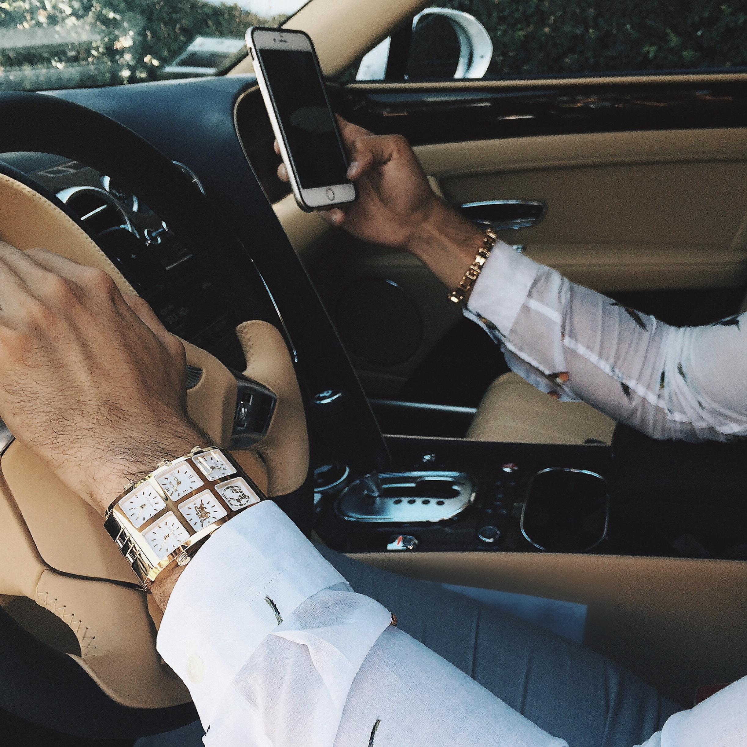 Man wearing Altan 60mm Multi-Time Zone Watch while driving