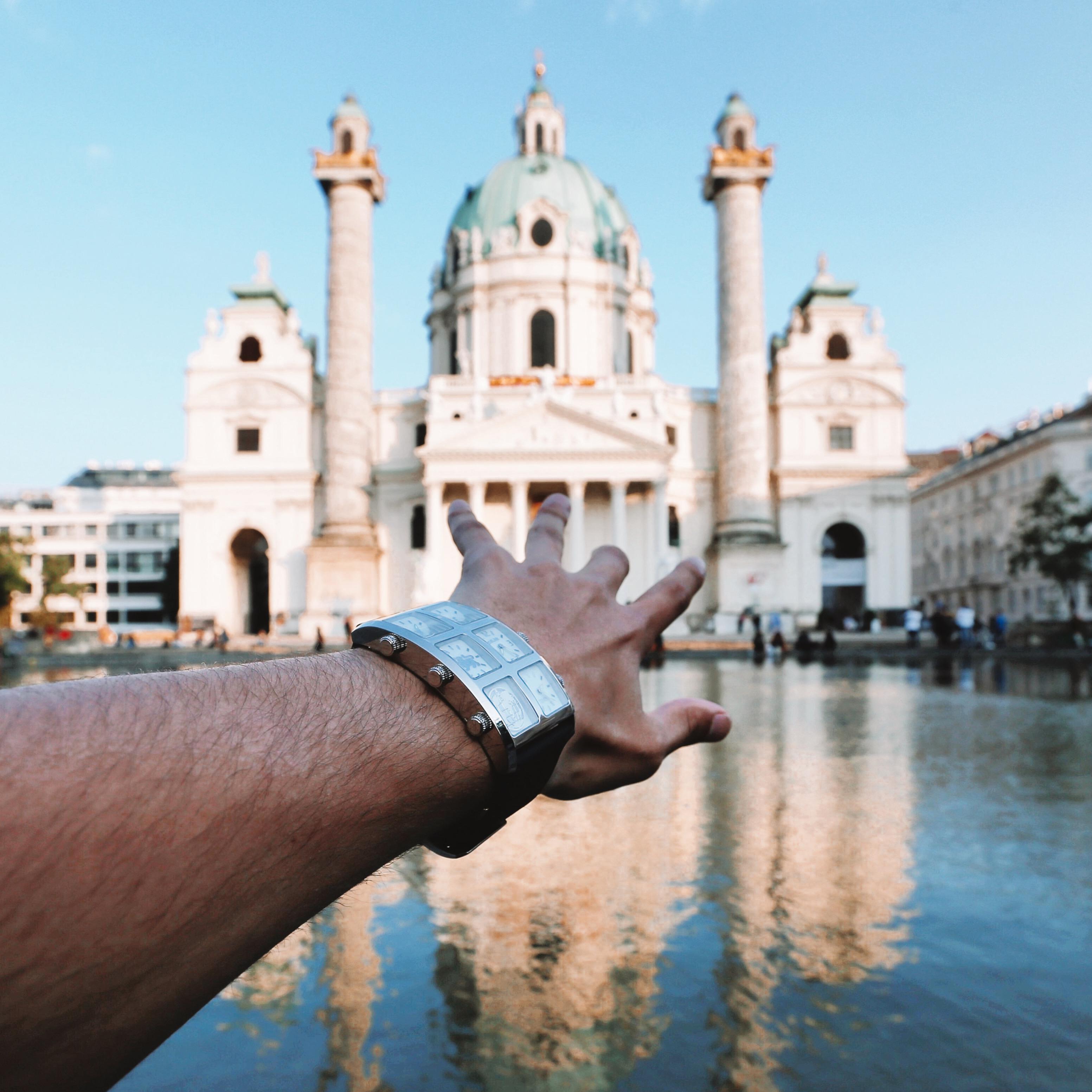 Man wearing Zhu 60mm Multi-Time Zone Watch in front of church