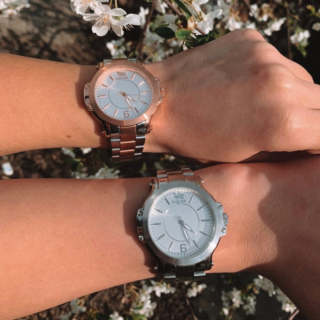 Two arms showing different finishes of the Steel & White Watch