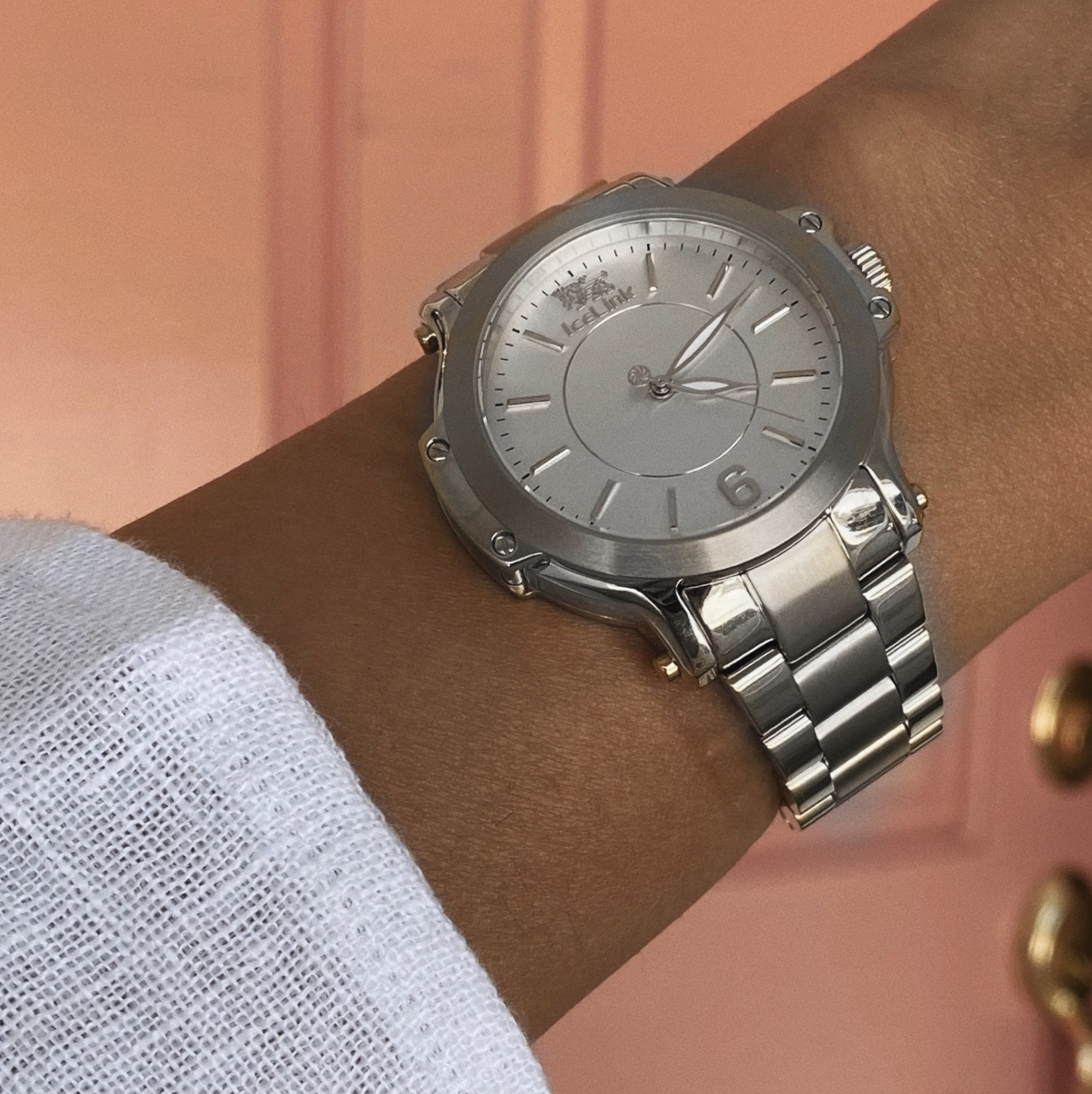 Close up of Steel & White Watch on woman's wrist