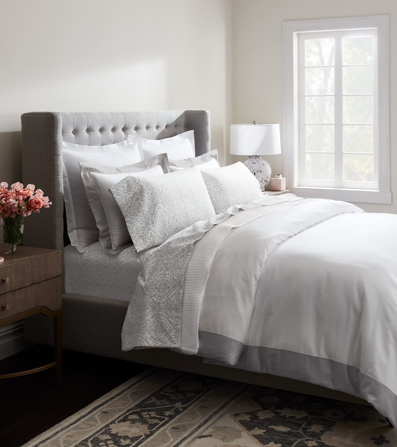 Side shot of bed with white sheets