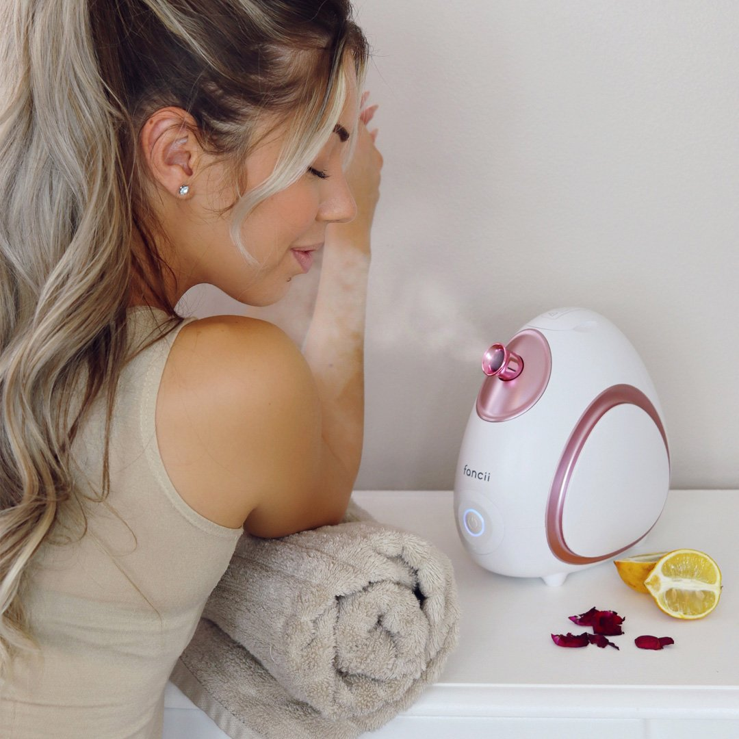 facial steamer with essential oil compartment