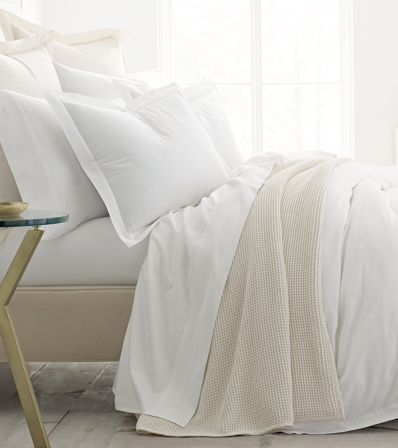 Side profile bed with white sheets