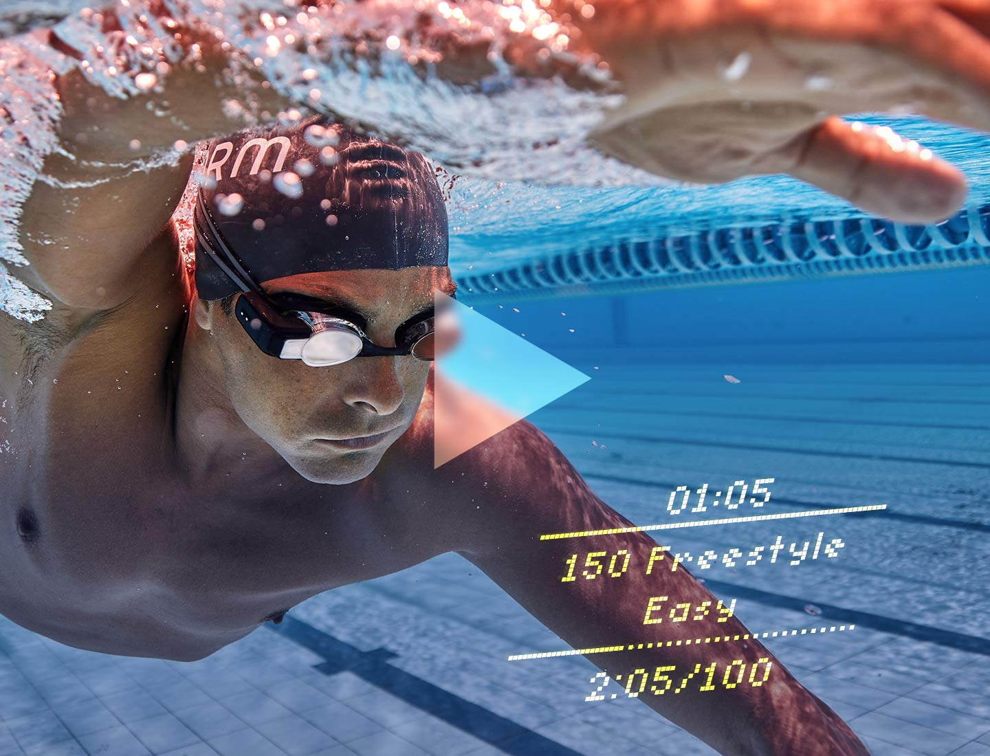 A swimmer wearing Form swim goggles with the in-goggle display showing the intensity of workout, time, and pace in real-time